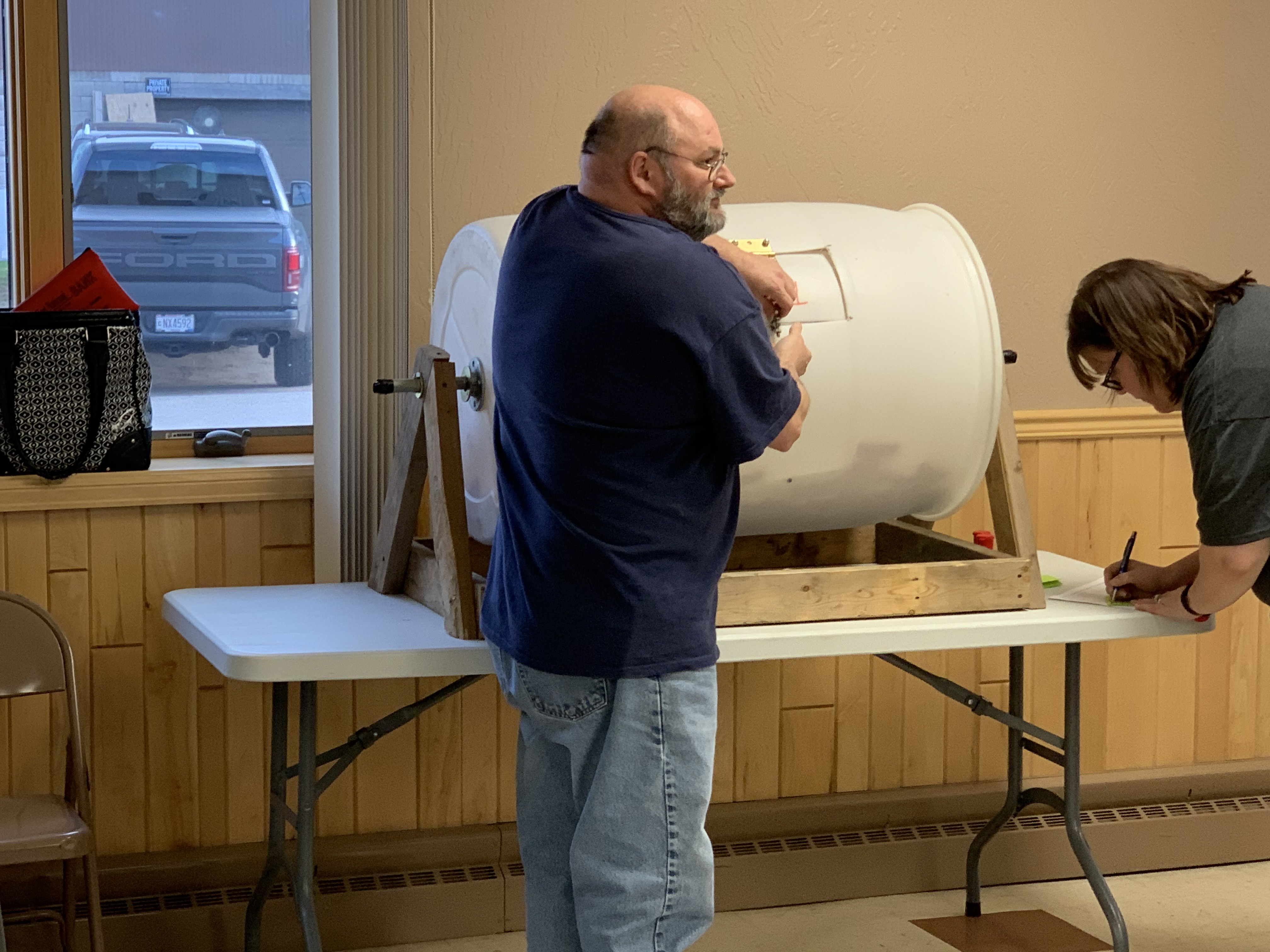 Lions Club President Kevin Willman picks tickets from people that entered into a raffle May 10 for items that contained a pop up hunting blind, a crossbow, a dehydrator and a cooler of alcohol among other items.Luke Reimer   NEW Media