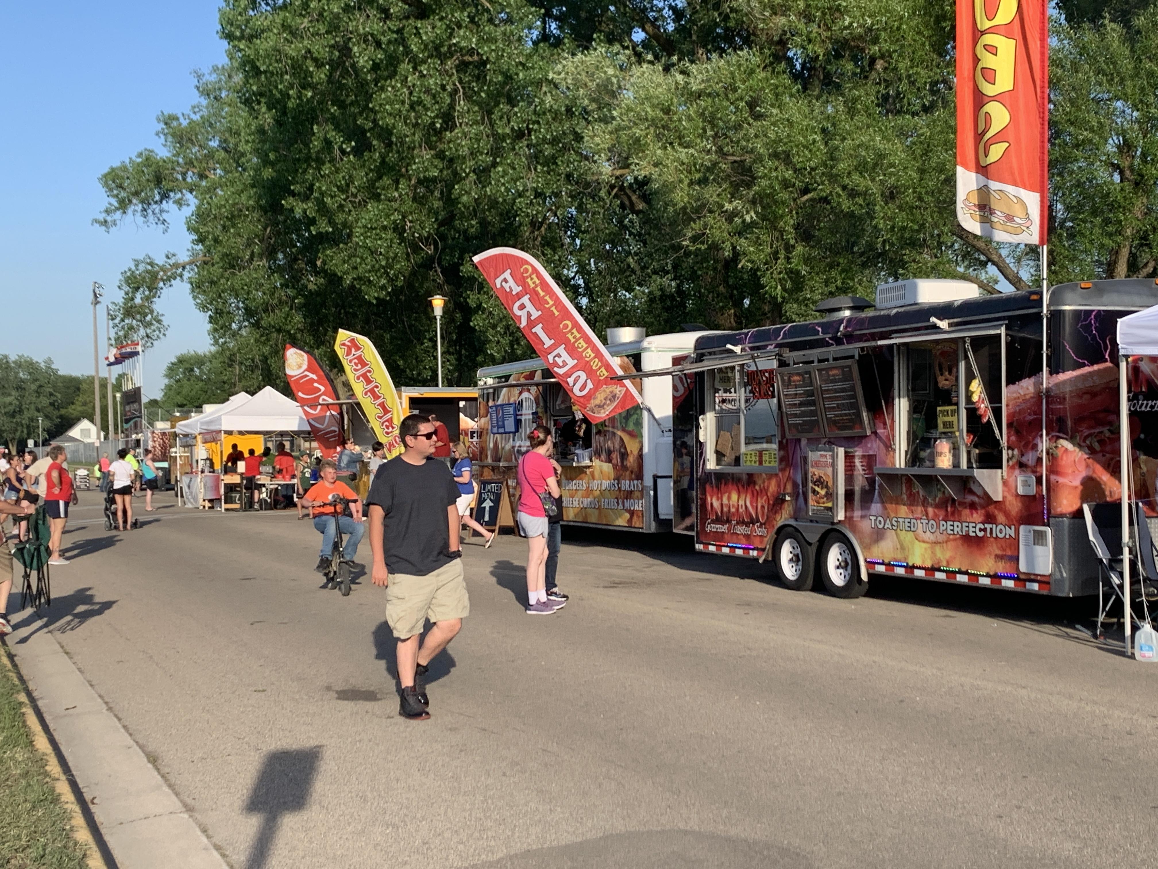 Food trucks line the side of East Elizabeth Street at Shawano Sun Drop Dayz on June 5.Luke Reimer   NEW Media