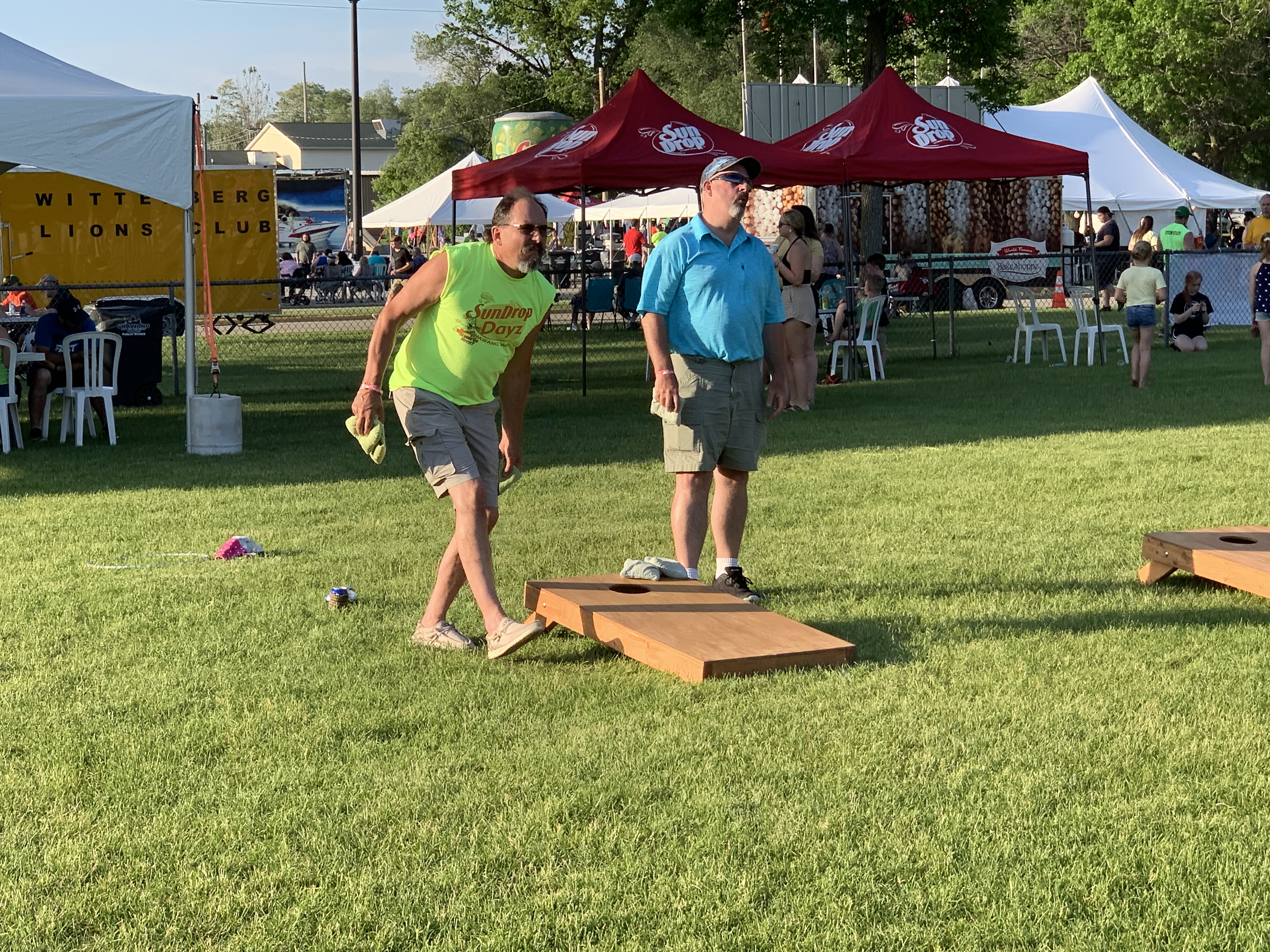 Jeff Kaster, left, and Tim Konitzer compete in a game of bean bag toss at Shawano Sun Drop Dayz on June 5.Luke Reimer   NEW Media