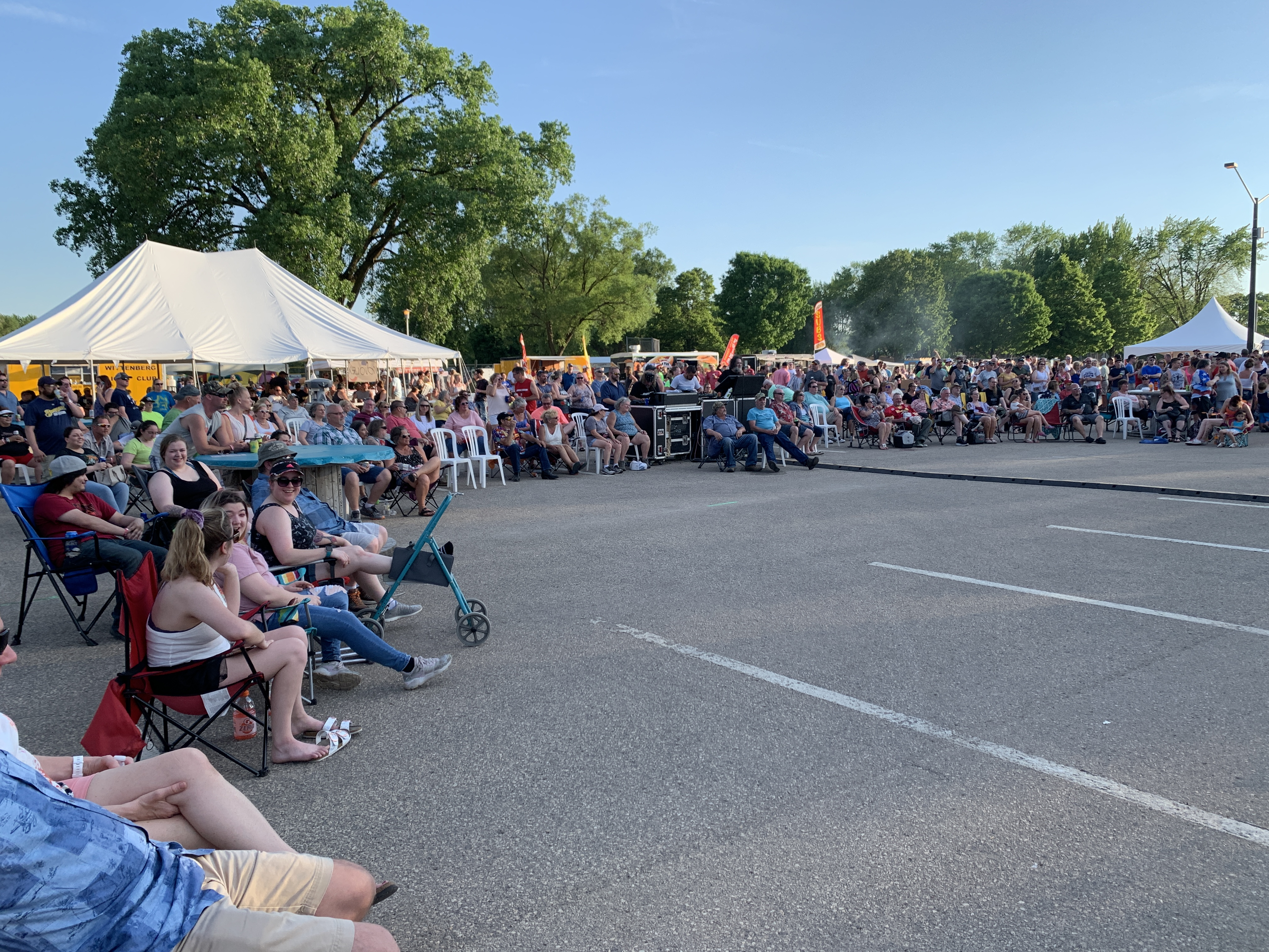 Hundreds of Shawano County residents and visitors fill Memorial Park to listen to Green Bay cover band Johnny Wad perform as Sun Drop Dayz wanes into the night.Luke Reimer   NEW Media