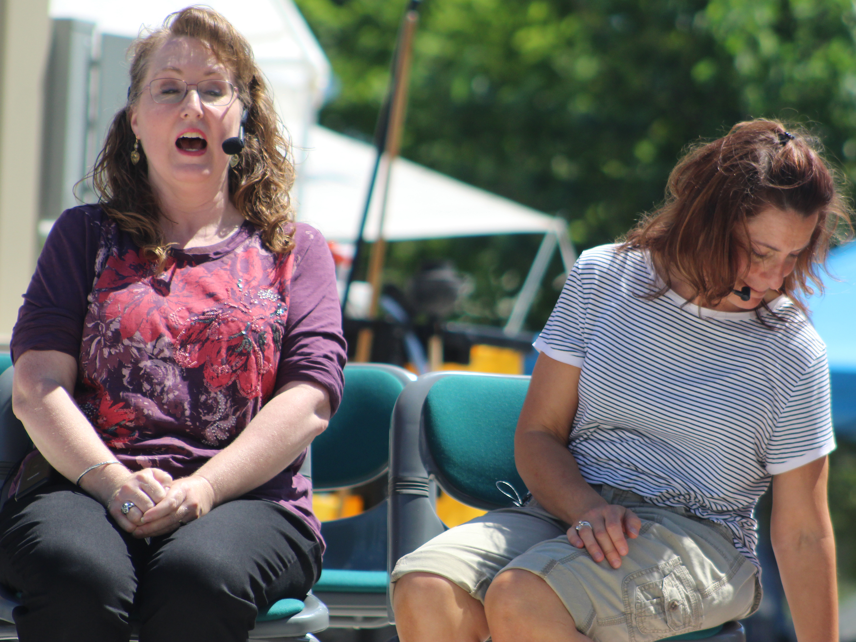 """Ginger, played by Sue Kluge, left, reacts to the judge's decision in a scene from """"Little Miss Fresno"""" as Doris, played by Jane Krueger, reaches for something in her bag. The one-act, written by Ara Watson and Mary Gallagher, was one of the theater pieces performed for Arts in the Park on June 12 at Franklin Park in Shawano.(Lee Pulaski 