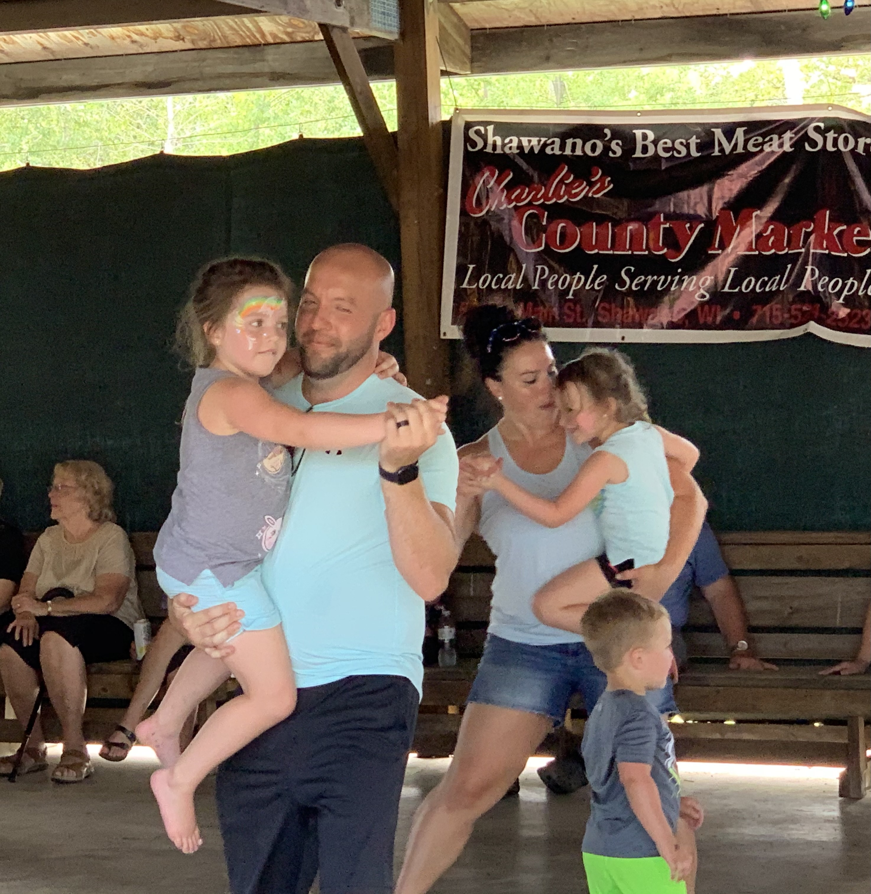Stevens Point resident Dan Tauferner carries his daughter Joann as they dance to the music of The Drovers in the Legion Park pavilion during Lumberjack Days on Aug. 29.Luke Reimer | NEW Media