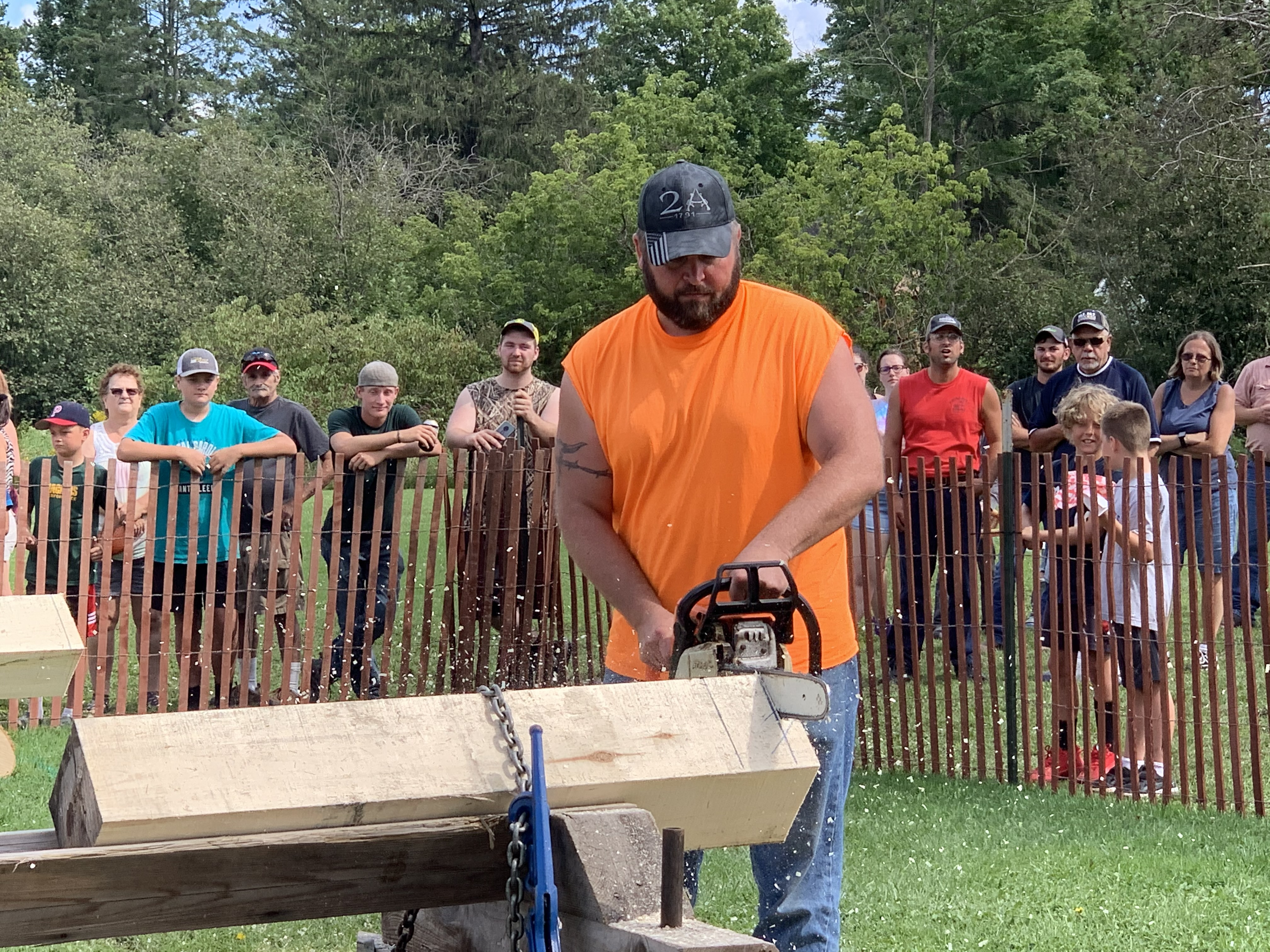 Travis Kielblock is calm and cool as dozens of visitors watch him saw wood and compete in the lumberjack competition at Legion Park on Aug. 29.Luke Reimer | NEW Media