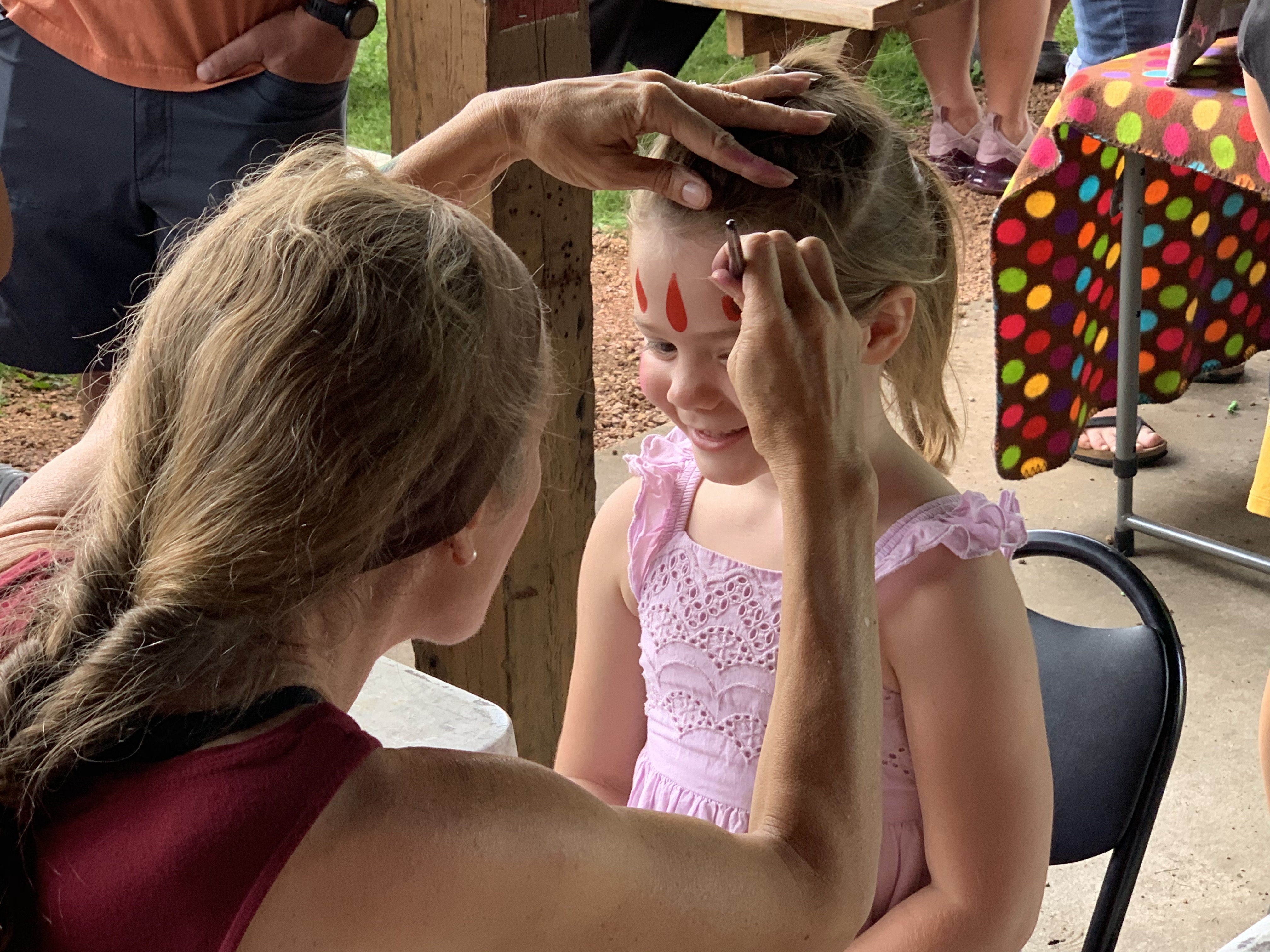Tigerton resident Lilly Eckardt is all smiles as she gets her face painted during Tigerton Lumberjack Days at Legion Park on Aug. 29.Luke Reimer | NEW Media