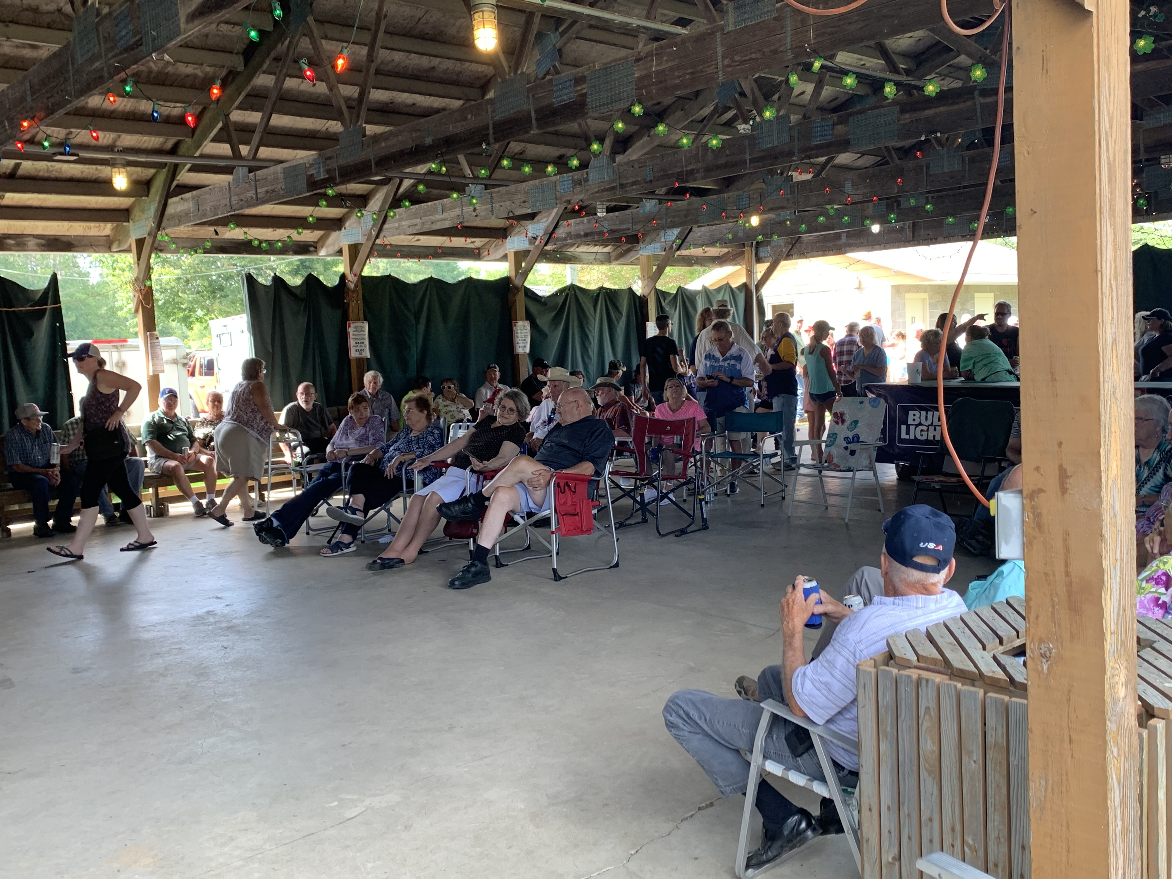 Dozens of visitors pack the Legion Park pavilion as they socialize, eat lunch and listen to music from The Drovers on Aug. 29.Luke Reimer | NEW Media