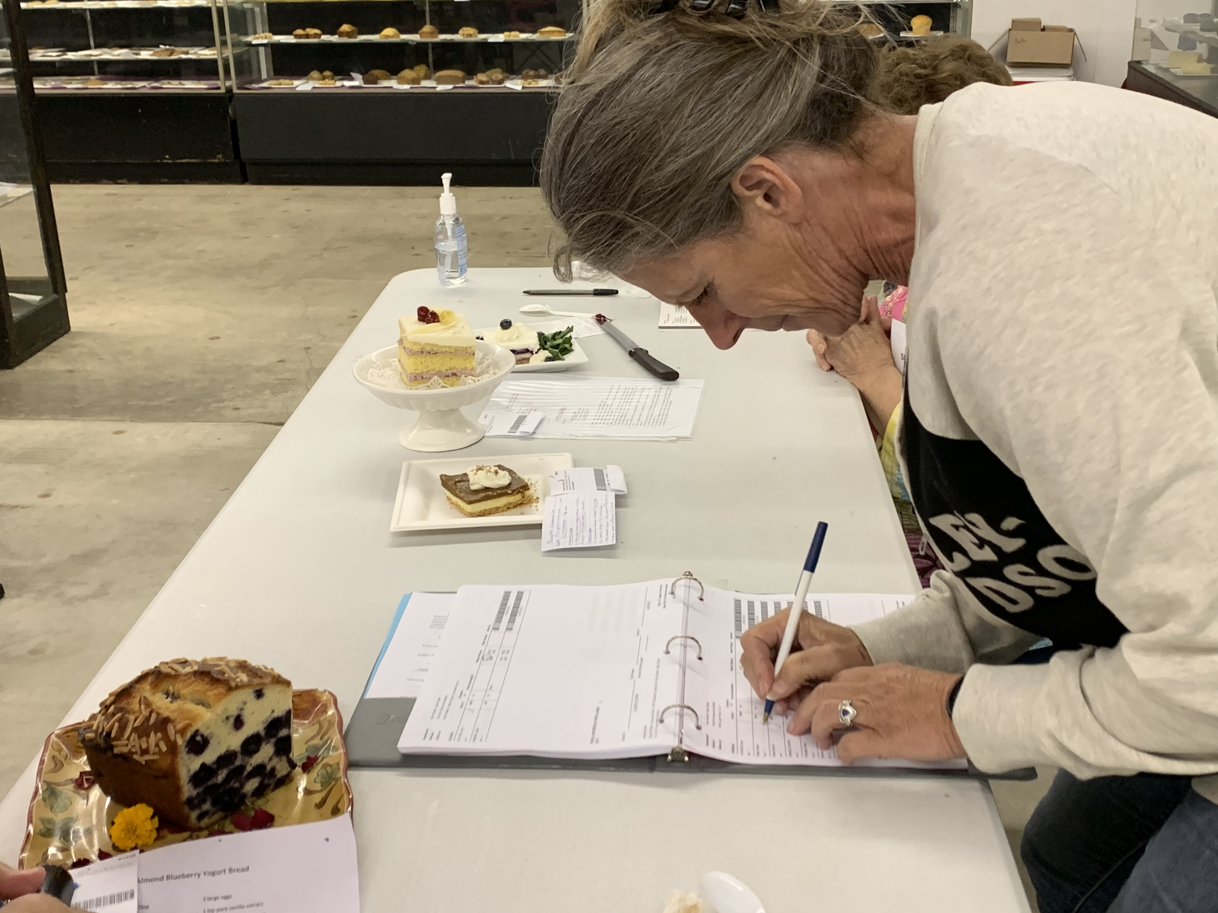 Judge Karrie Dollar writes notes about the food presented to her during the food and nutrition preservation event at the Shawano County Fair on Sept. 3.(Luke Reimer   NEW Media)