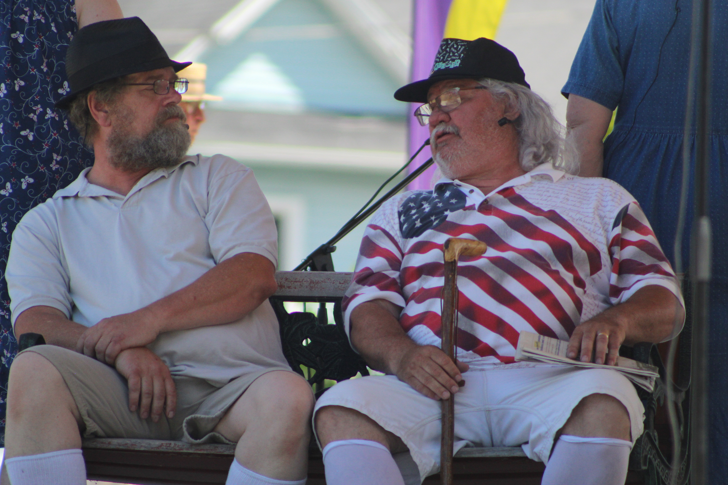 """Brothers Floyd and Henry, played by Dave Hackbarth, left, and Ralph Beversdorf, reminisce about their late wives in """"The Geezers,"""" which is part of the play """"Characters"""" written by Don Everts. The scene was part of Arts in the Park, held June 12 at Franklin Park in Shawano. The event was put on by the Shawano County Arts Council and its subsidiaries, Box in the Wood Theatre Guild and the Shawano County Folk Music Festival.<br />(Lee Pulaski 