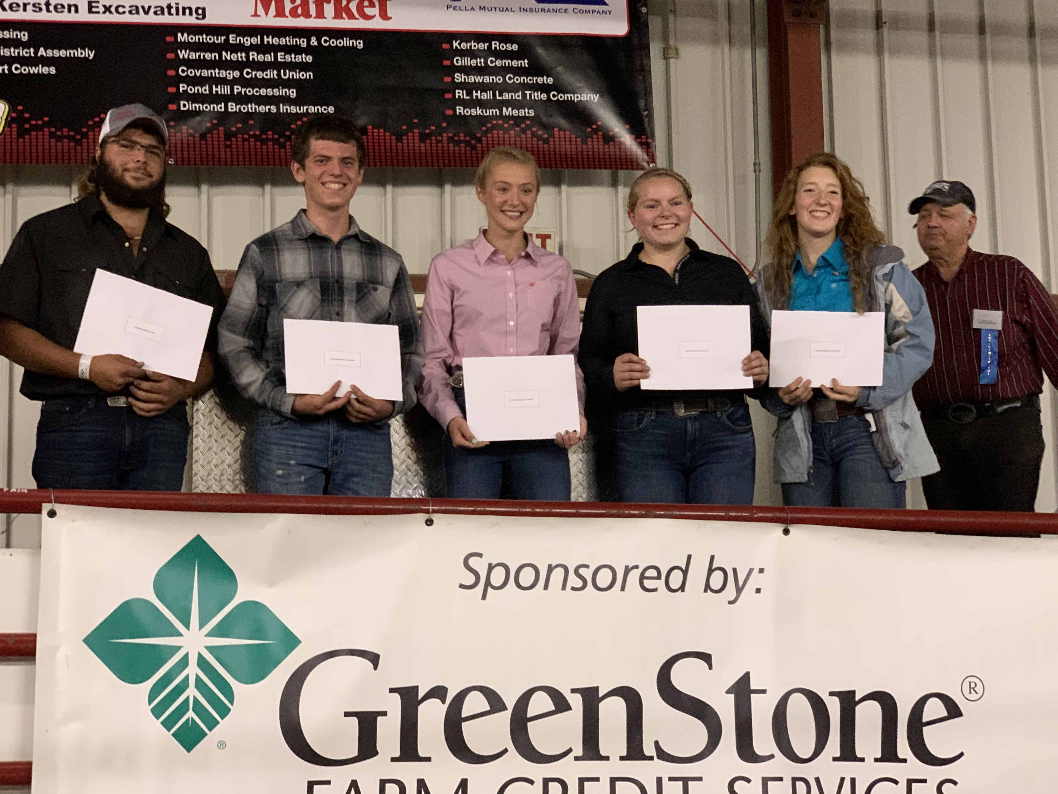 From left, Eli Inman, Hunter Holewinski, Mandi McClone, Alyssa Strassburg and Hannah Cerveny receive scholarships from the Shawano County 4-H Livestock committee before the livestock auction at the Shawano County Fair on Sept. 3.<br />(Luke Reimer   NEW Media)
