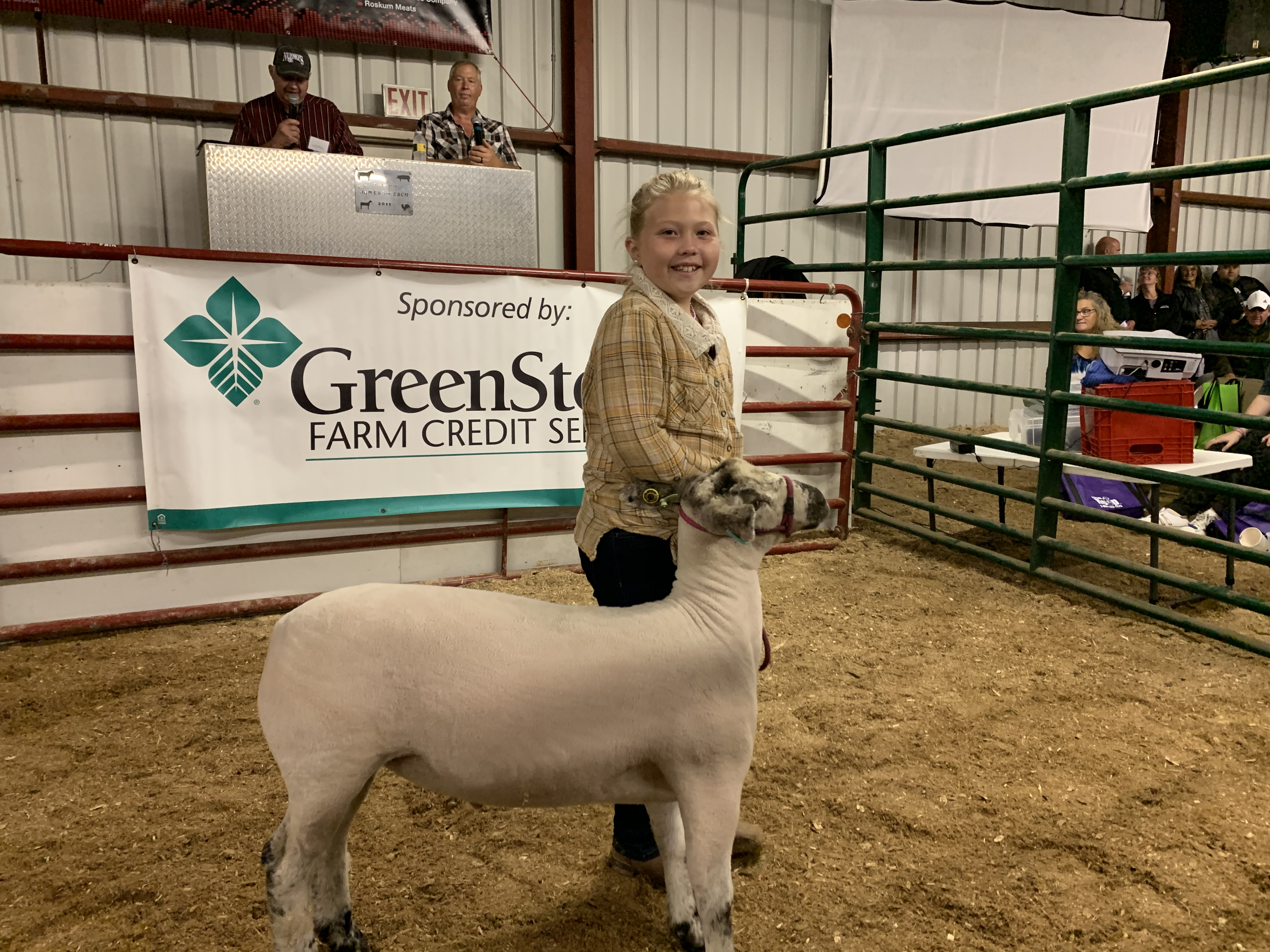 Green Valley resident and first year show participant Deanna Smith has a big smile on her face as she walks her sheep around for the first time during the livestock auction at the Shawano County Fair on Sept. 3.(Luke Reimer   NEW Media)