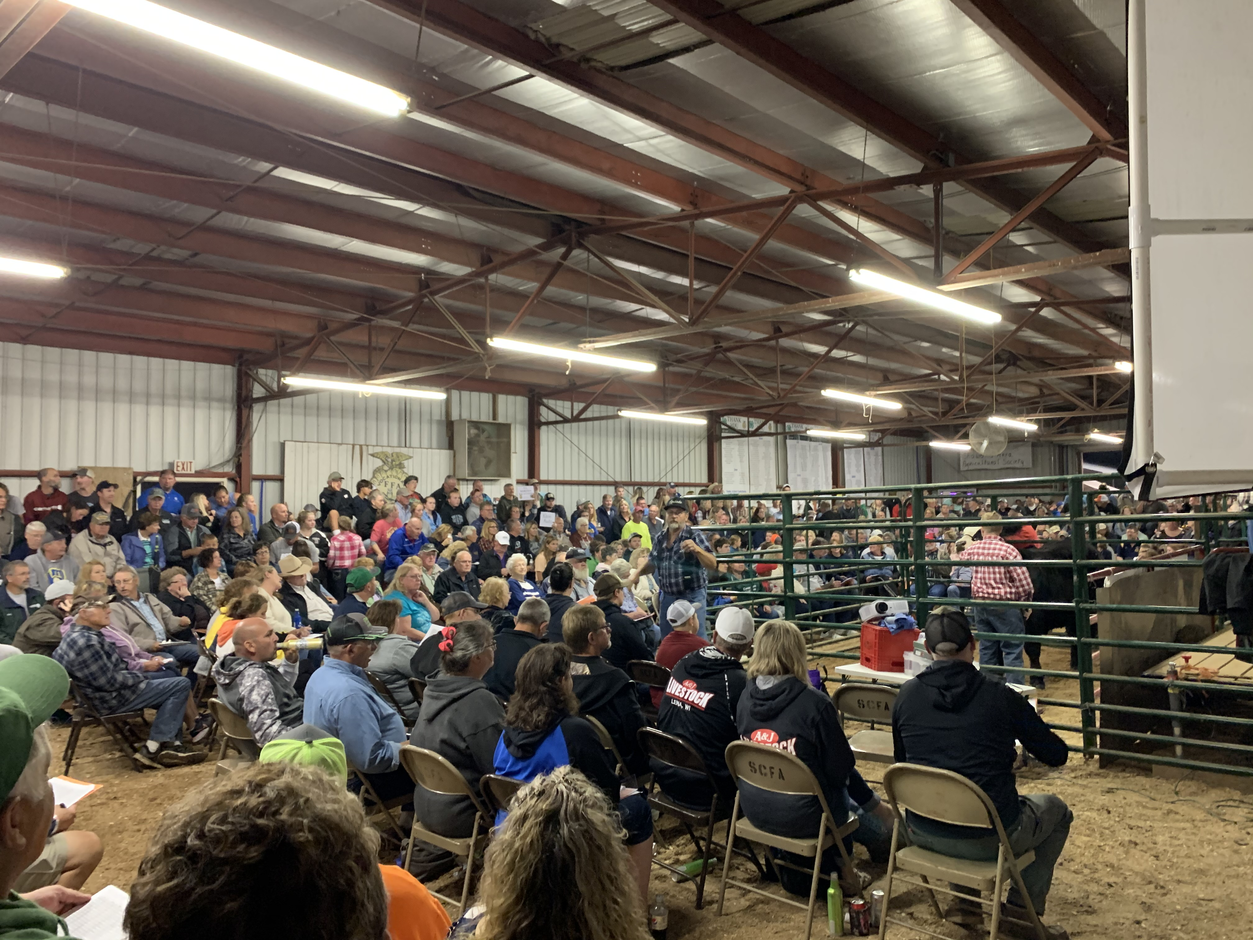 The Coliseum was packed with visitors that wanted to bid on livestock at the Shawano County Fair during the livestock auction on Sept. 3.(Luke Reimer   NEW Media)