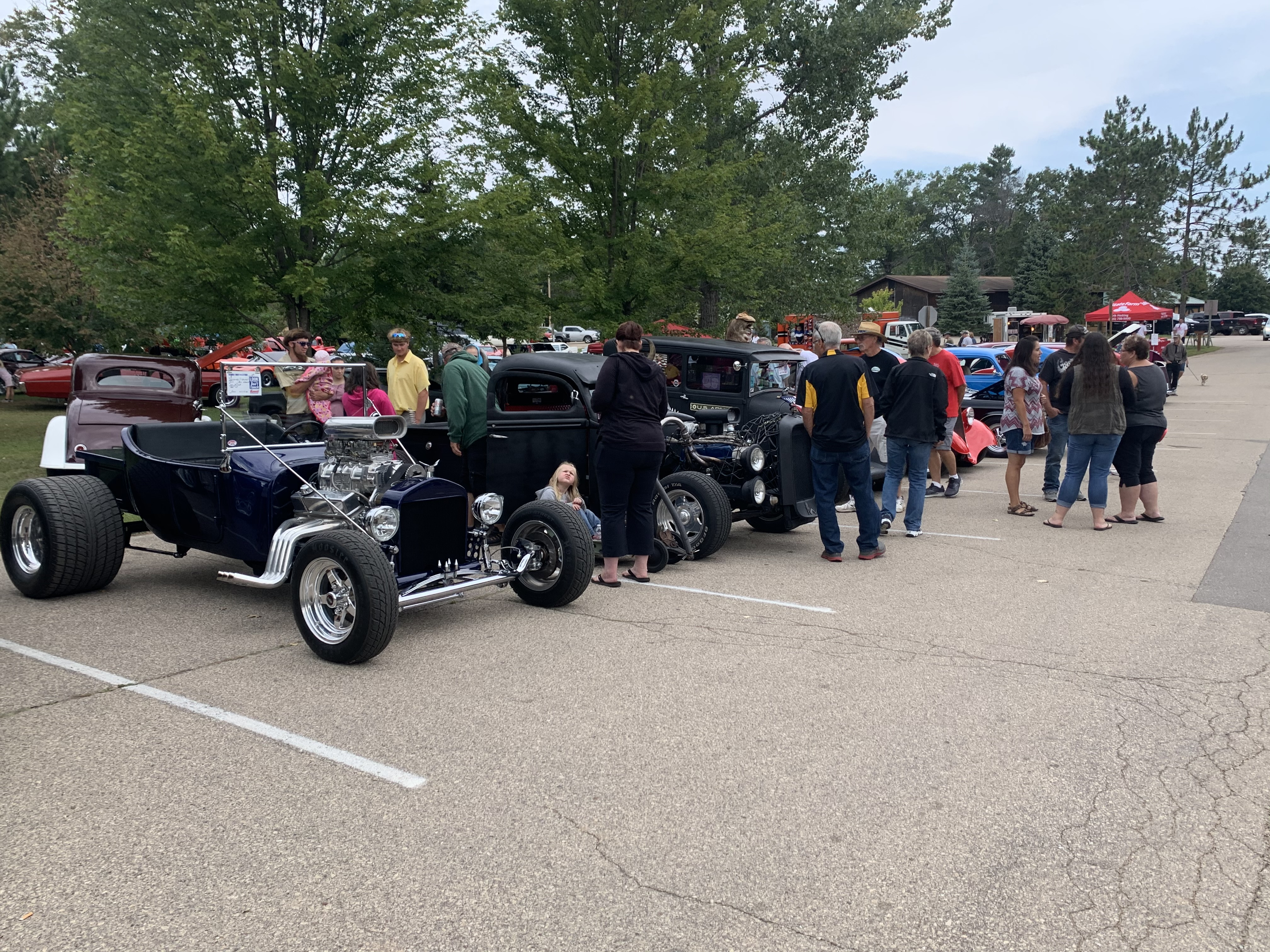 Crowds congregate by a group of hot rods at the car show at Shawano Lake County Park on Sept. 12.Luke Reimer | NEW Media