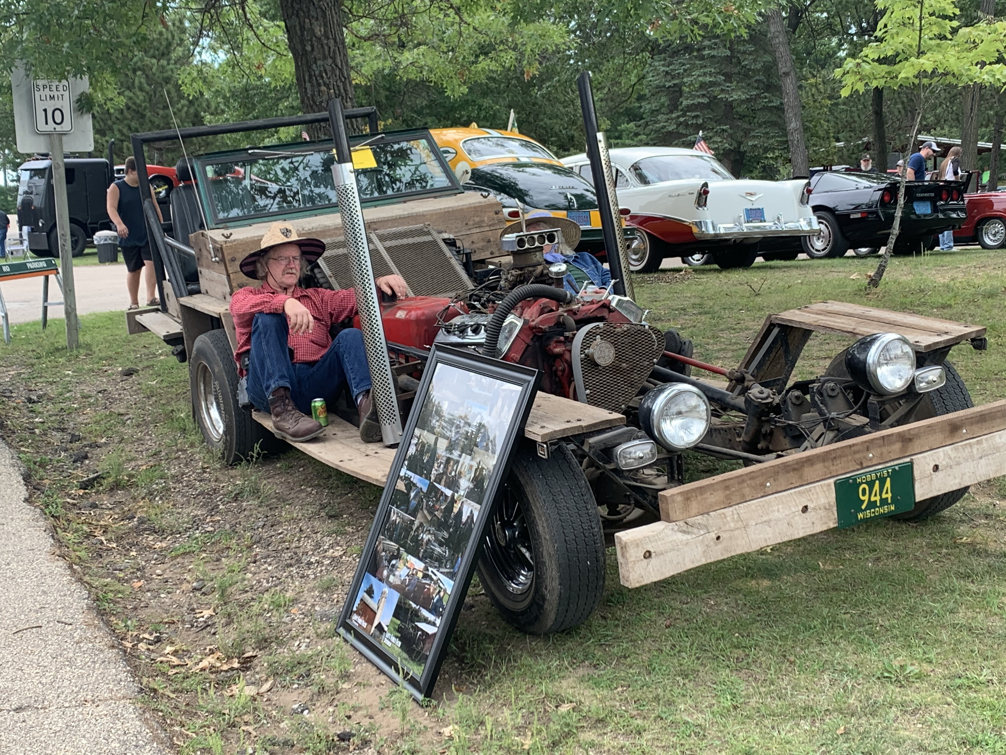 """Shawano residents Leo, left, and Deb Frank sit in their custom wooden car during the car show at Shawano Lake County Park on Sept. 12. The car was featured on an episode of """"American Pickers.""""Luke Reimer 