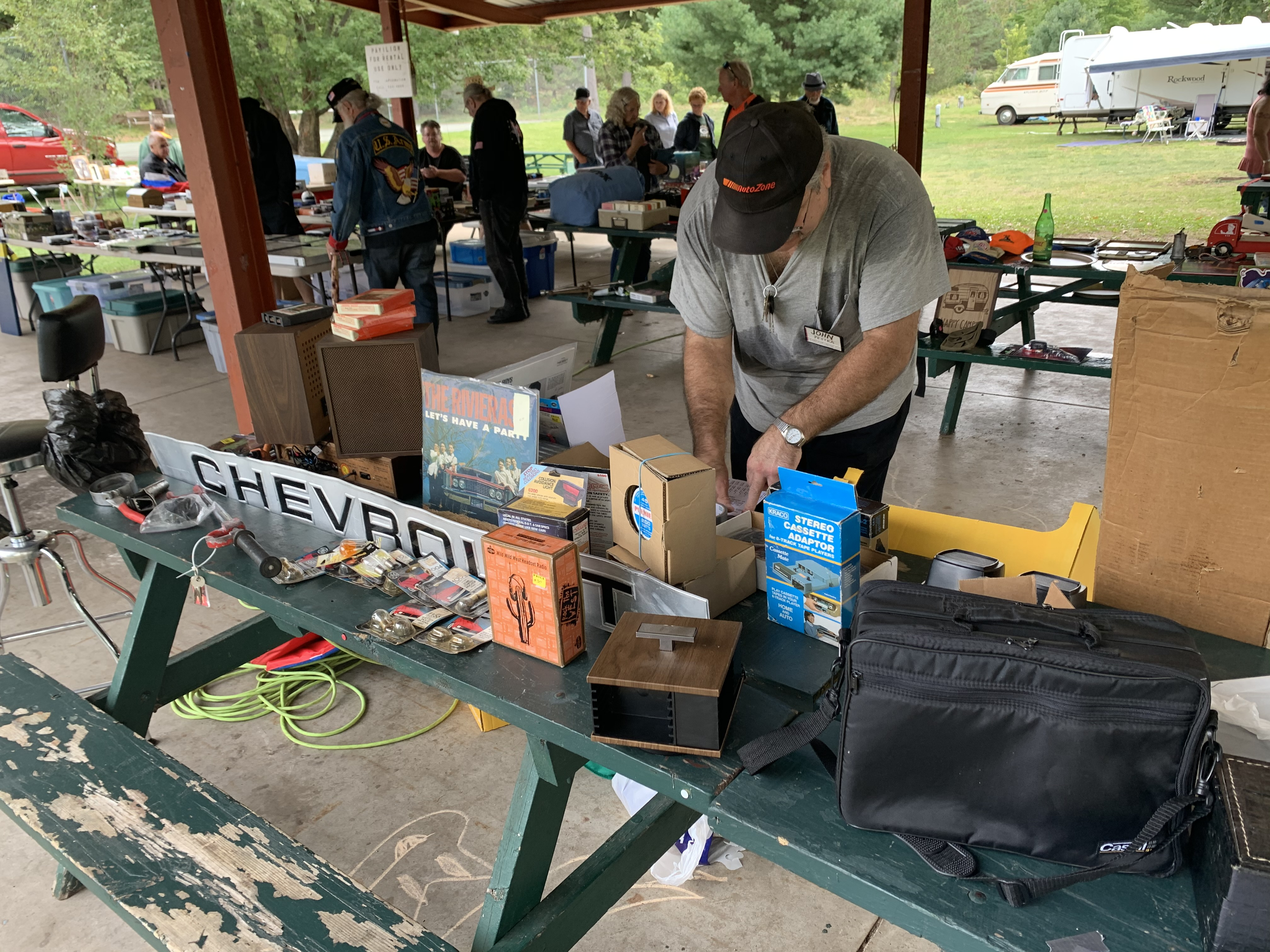John Pestka gets his table ready during a swap meet that took place as part of the car show at Shawano Lake County Park on Sept. 12.Luke Reimer | NEW Media