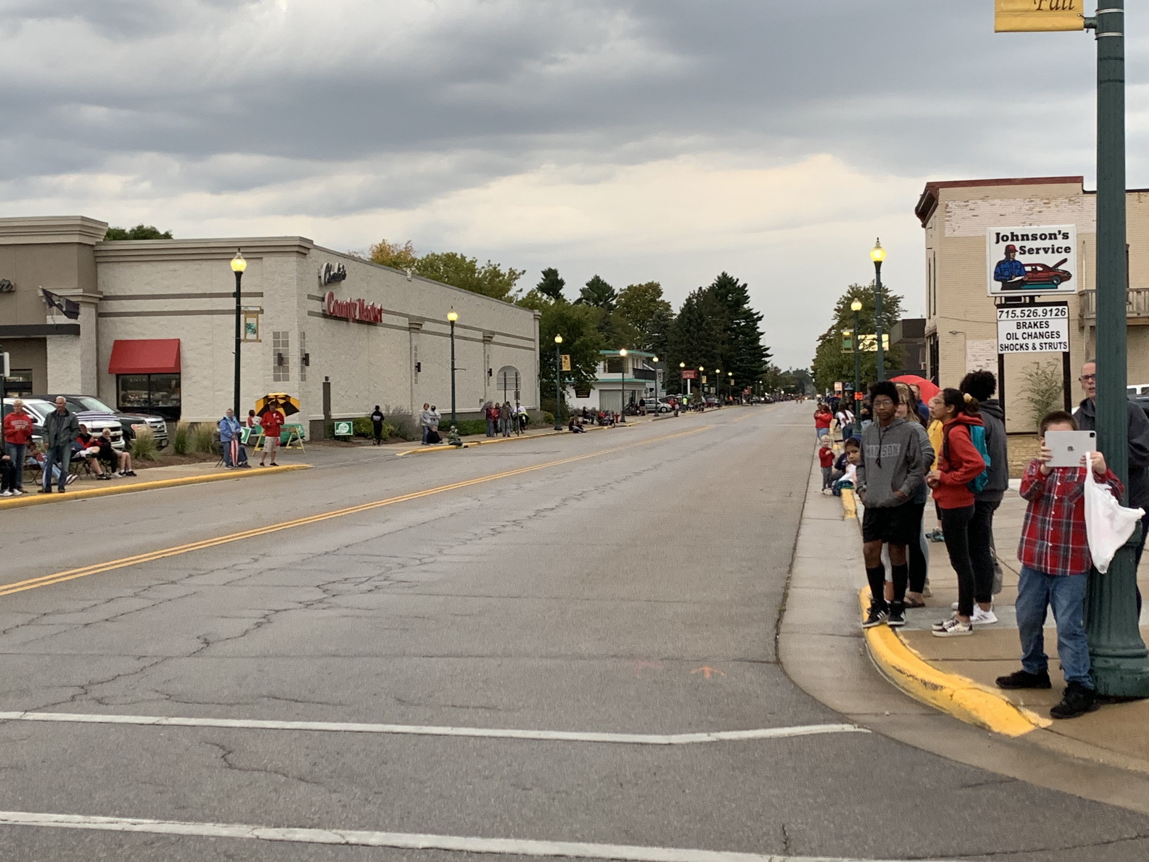 Shawano homecoming parade visitors wait in anticipation on Main Street before participants of the parade pass through.Luke Reimer | NEW Media
