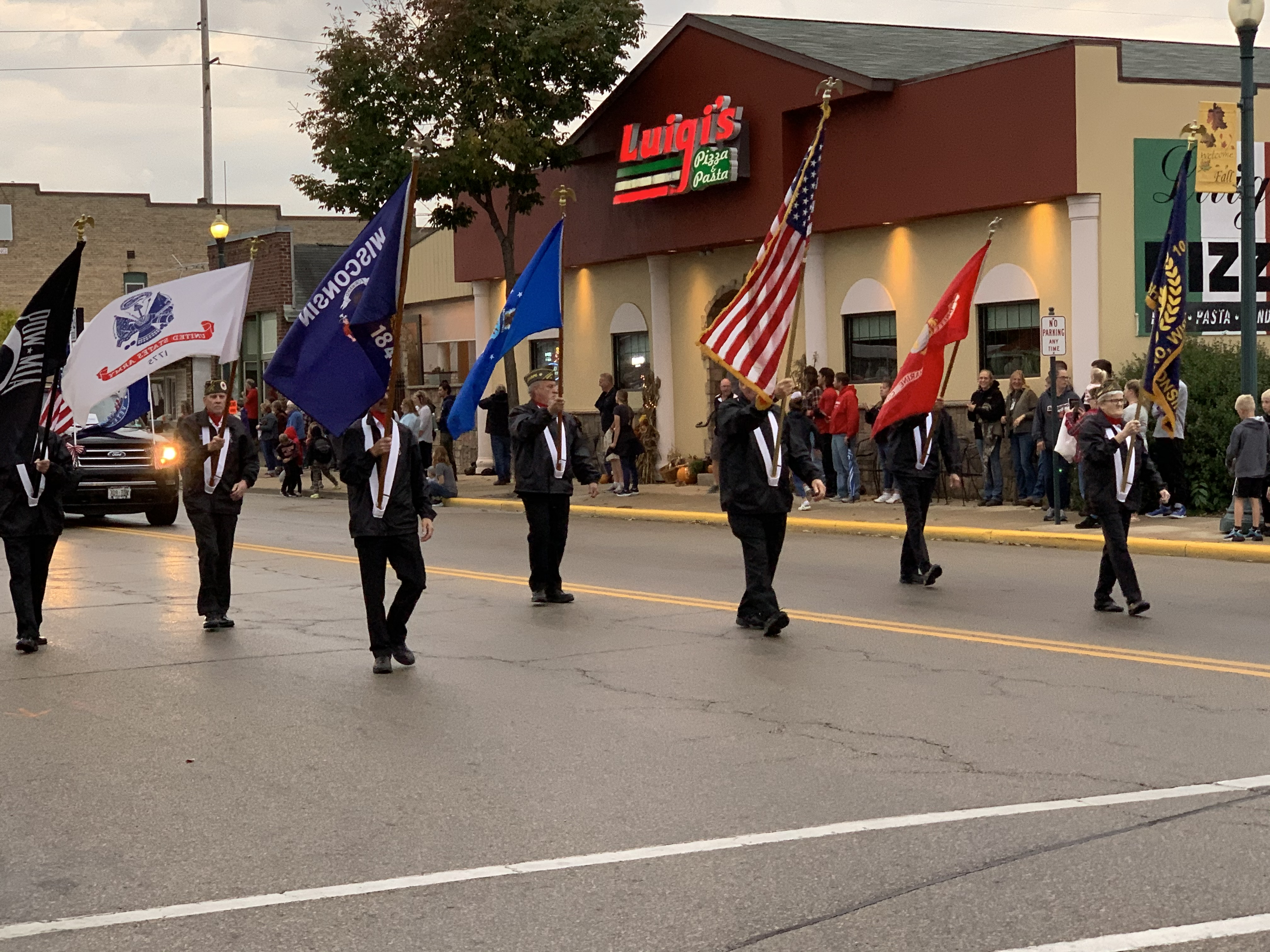 The American flag is prominently flown next to other flags as veterans lead the march of the homecoming parade in Shawano on Sept. 24.Luke Reimer | NEW Media