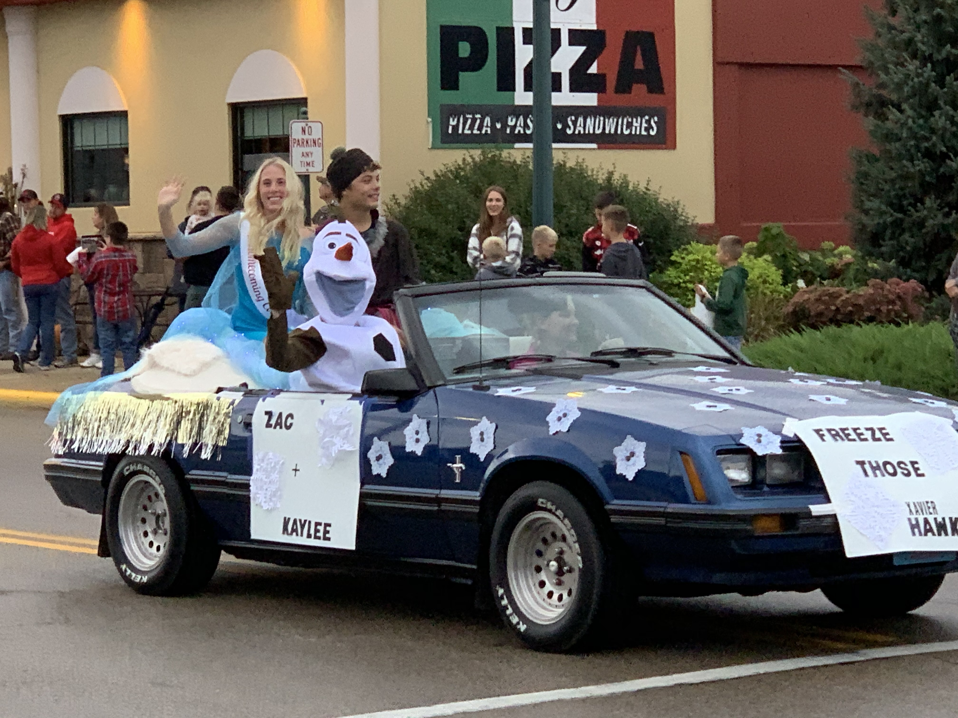 """In an effort to """"freeze"""" the rival Xavier Hawks, a float containing the """"Frozen"""" character Olaf greets visitors on Main Street during the Sept. 24 homecoming parade.Luke Reimer 