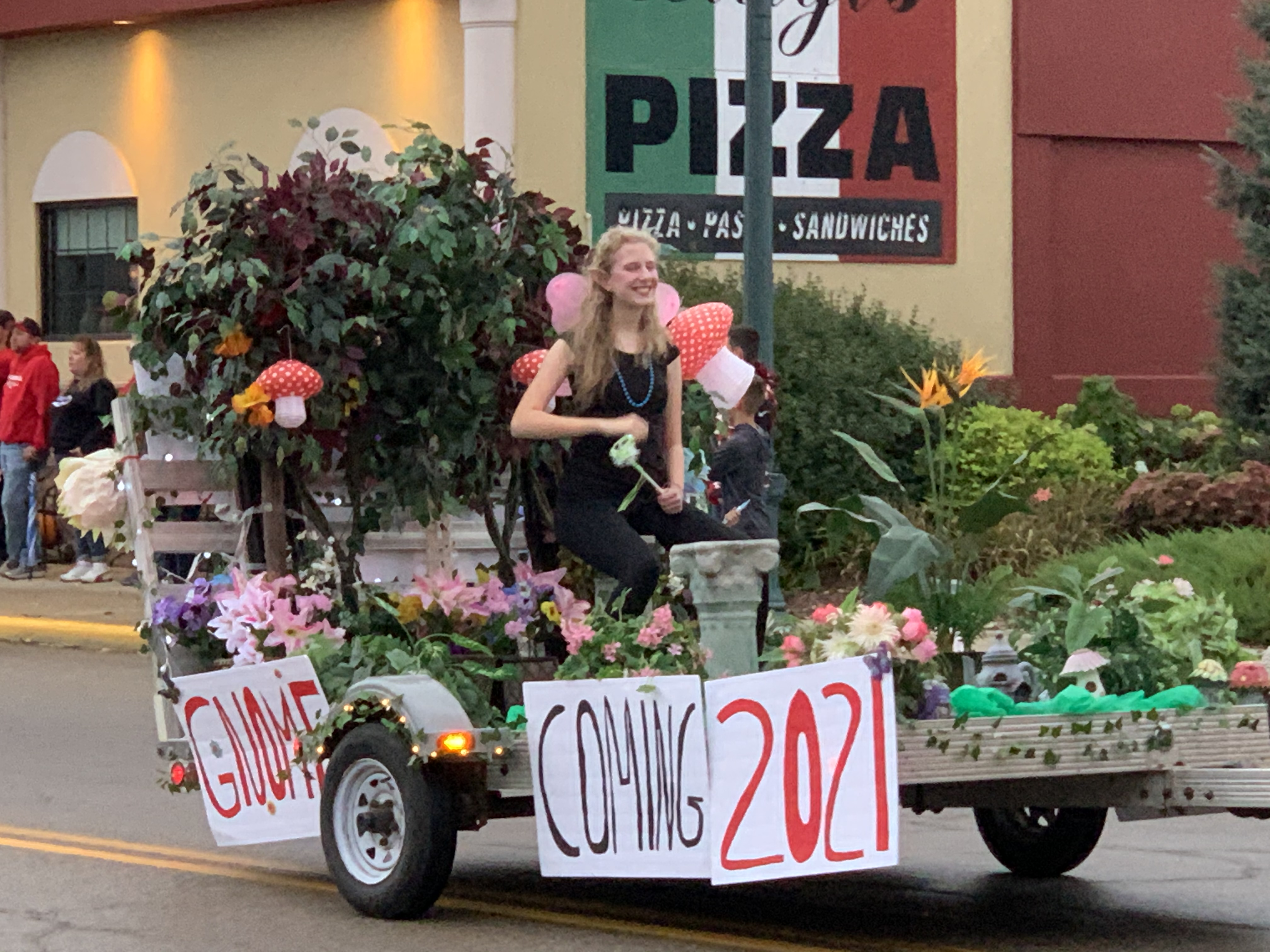 """With a play on the word """"homecoming,"""" one float features grass and a gnome — titled """"gnomecoming"""" — during the traditional parade Sept. 24.Luke Reimer 