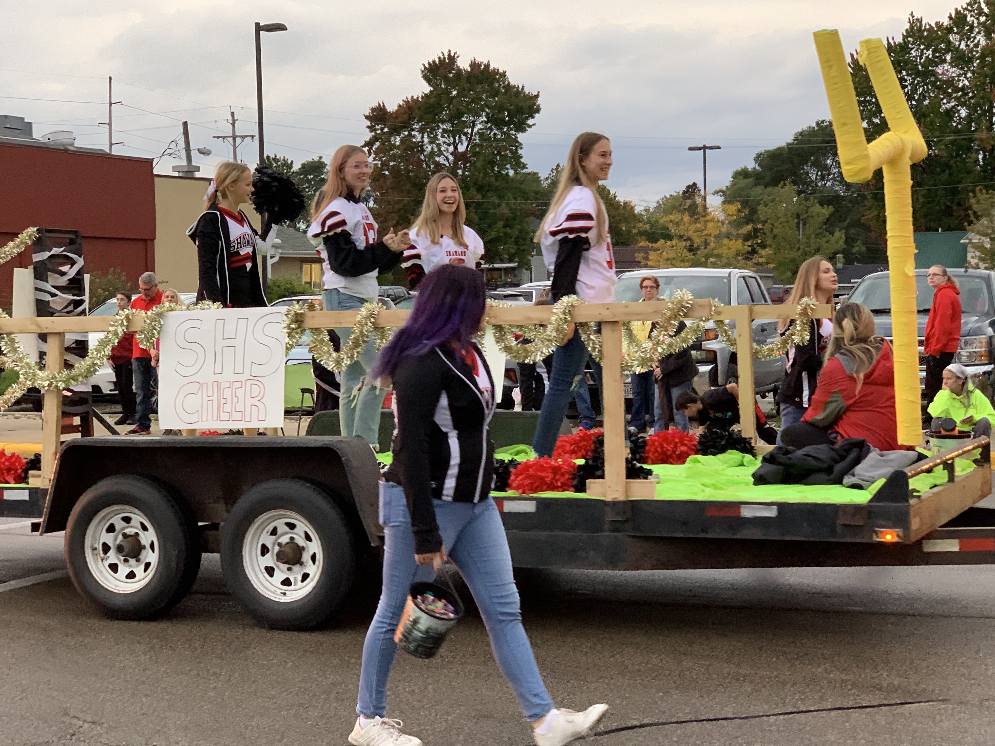 The Shawano cheer squad marches down Main Street in a football field-themed float during the Sept. 24 homecoming parade.Luke Reimer | NEW Media