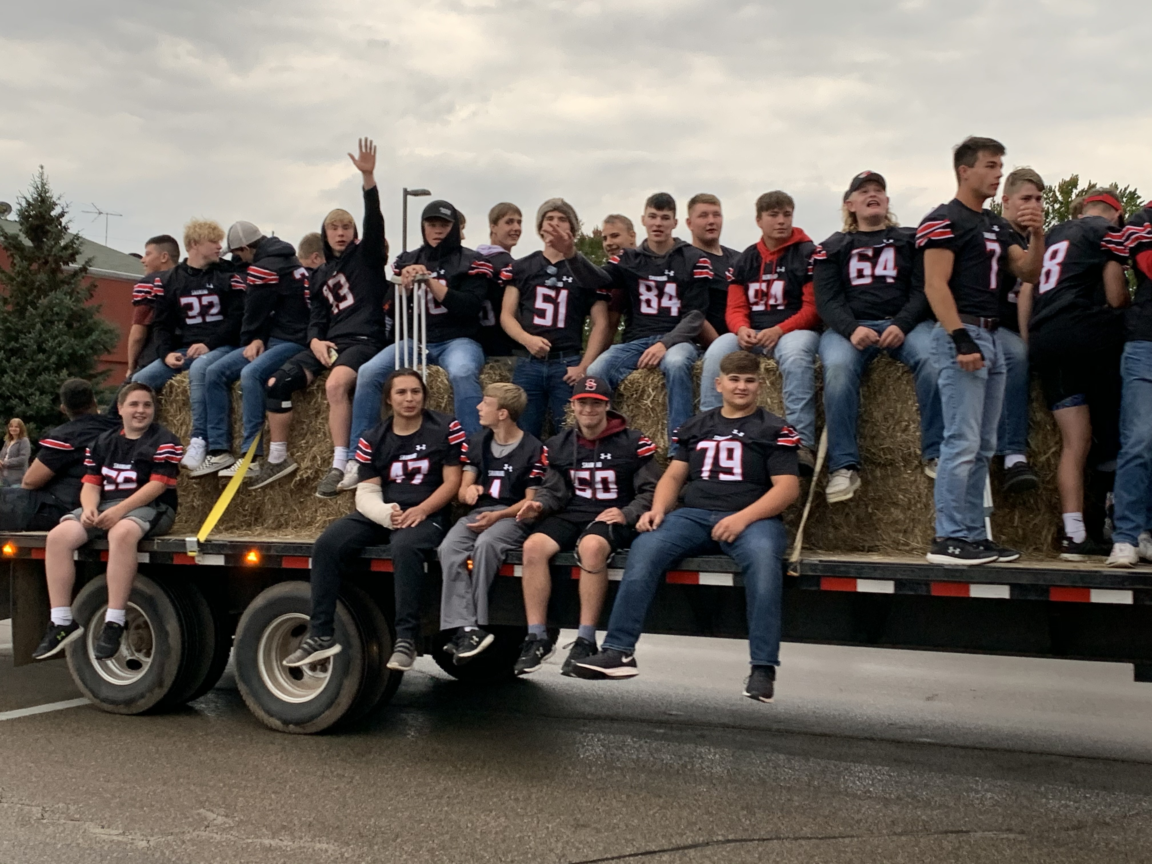 Shawano football players wave to visitors at the homecoming parade as they prepare to take on the Xavier Hawks on Sept. 24.Luke Reimer | NEW Media