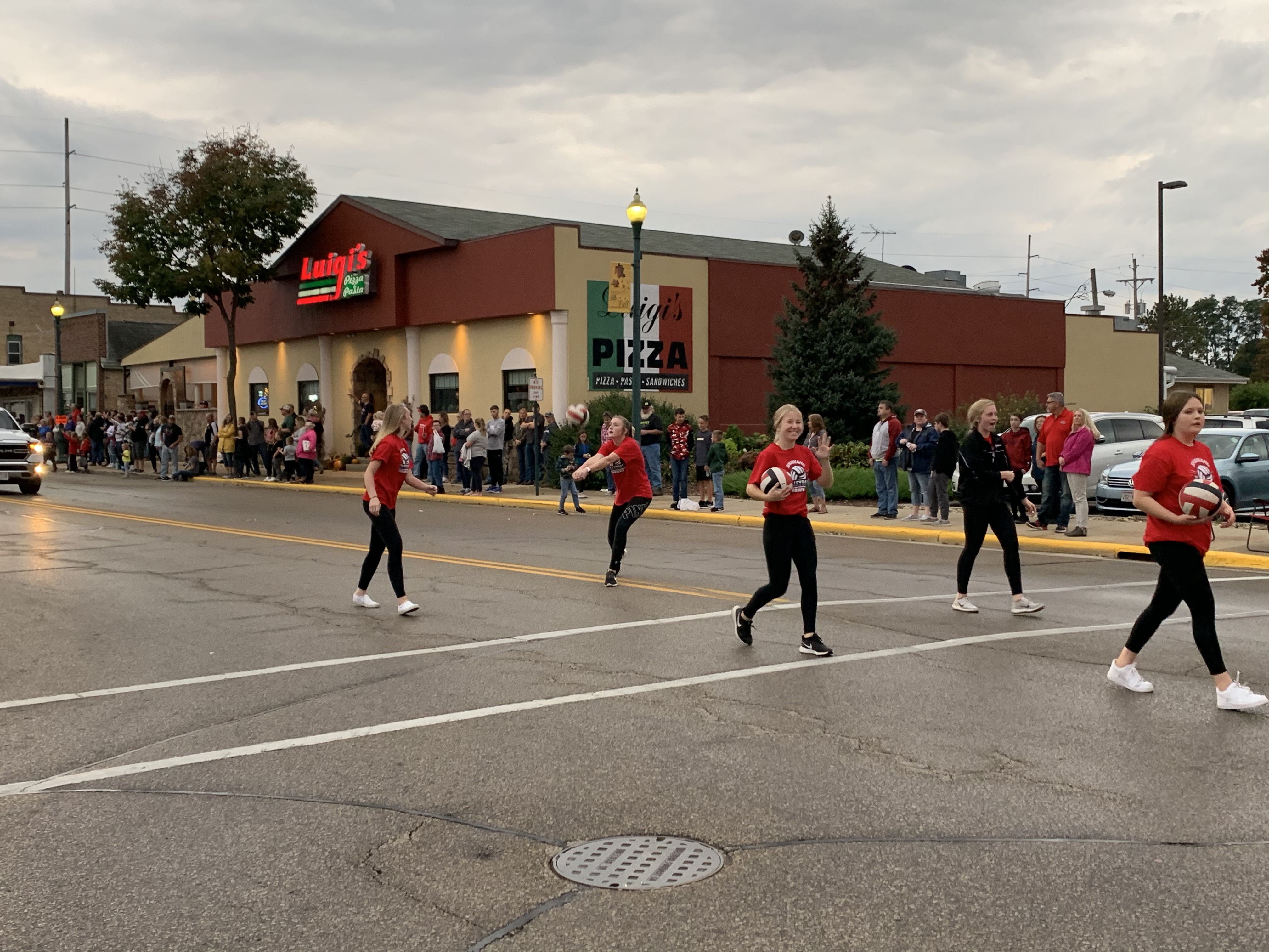 The Shawano volleyball team bumps, sets and spikes balls back and forth as they march down Main Street during the homecoming parade on Sept. 24.Luke Reimer | NEW Media