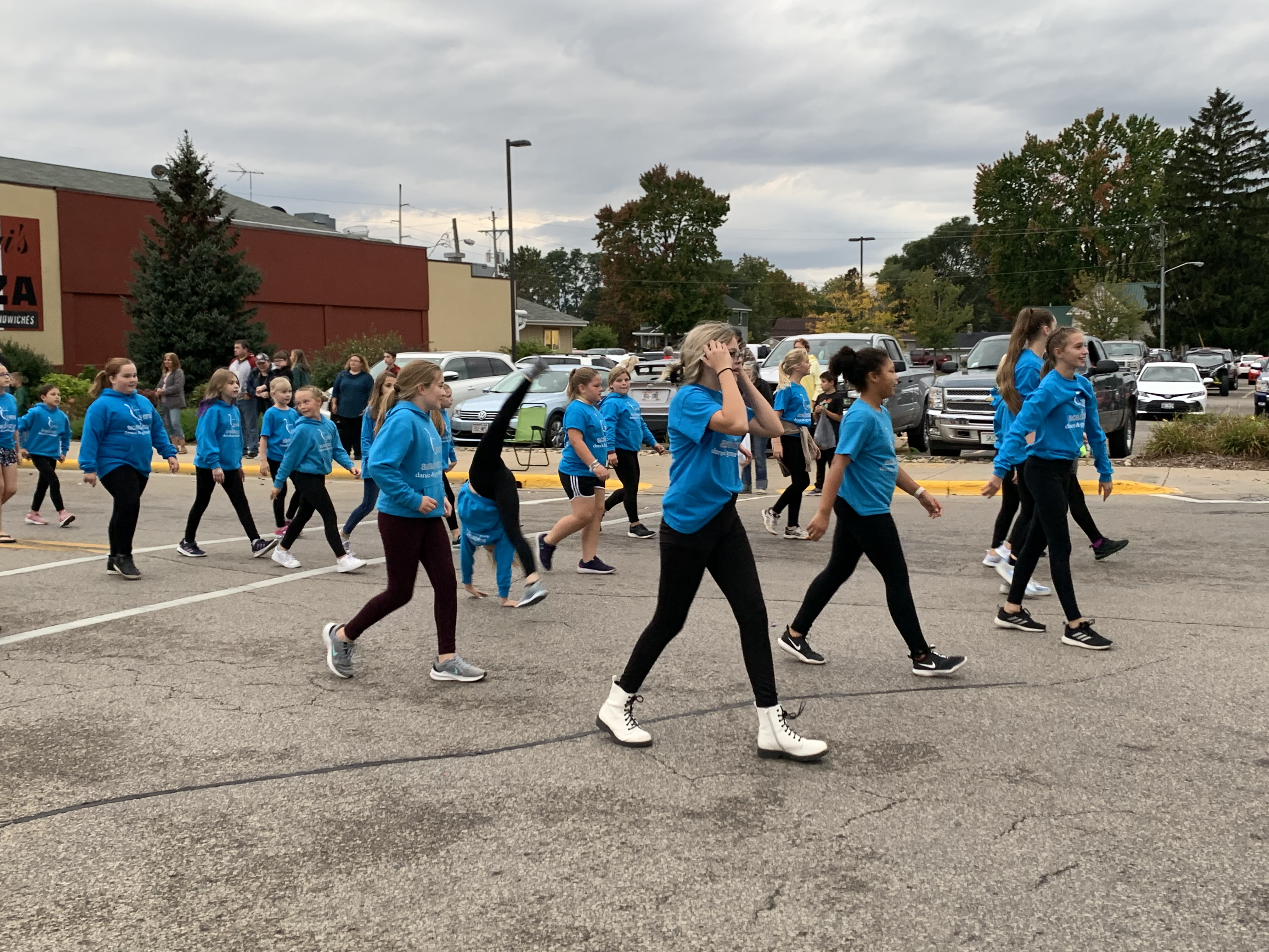 Girls involved with the Vera Dance Academy dance and cartwheel their way down Main Street during the homecoming parade on Sept. 24.Luke Reimer | NEW Media