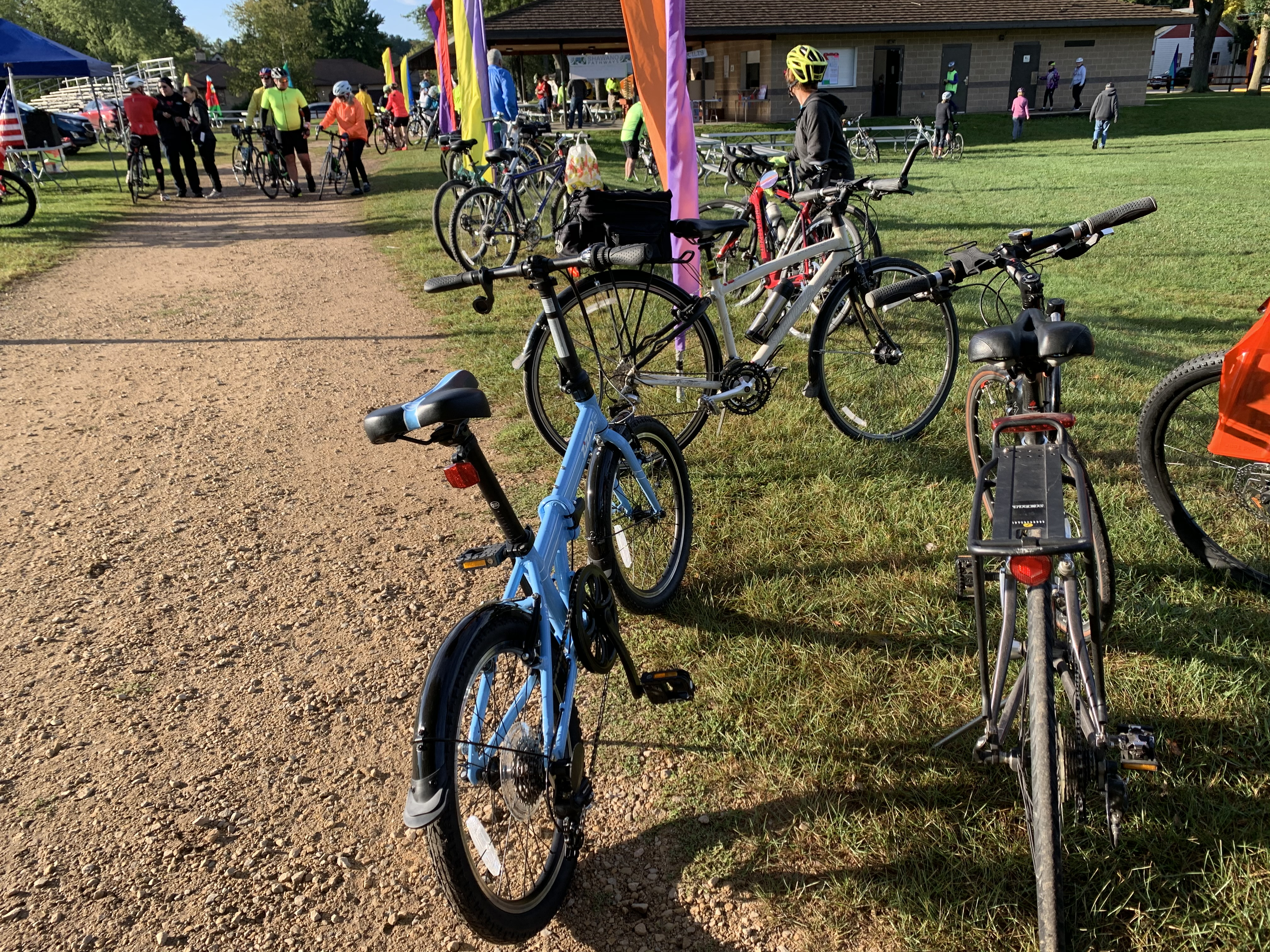 Bikes are parked in Memorial Park during the Bike the Barn Quilts event as participants register and prepare to see some of Shawano County's 300-plus barn quilts Sept. 25.Luke Reimer   NEW Media