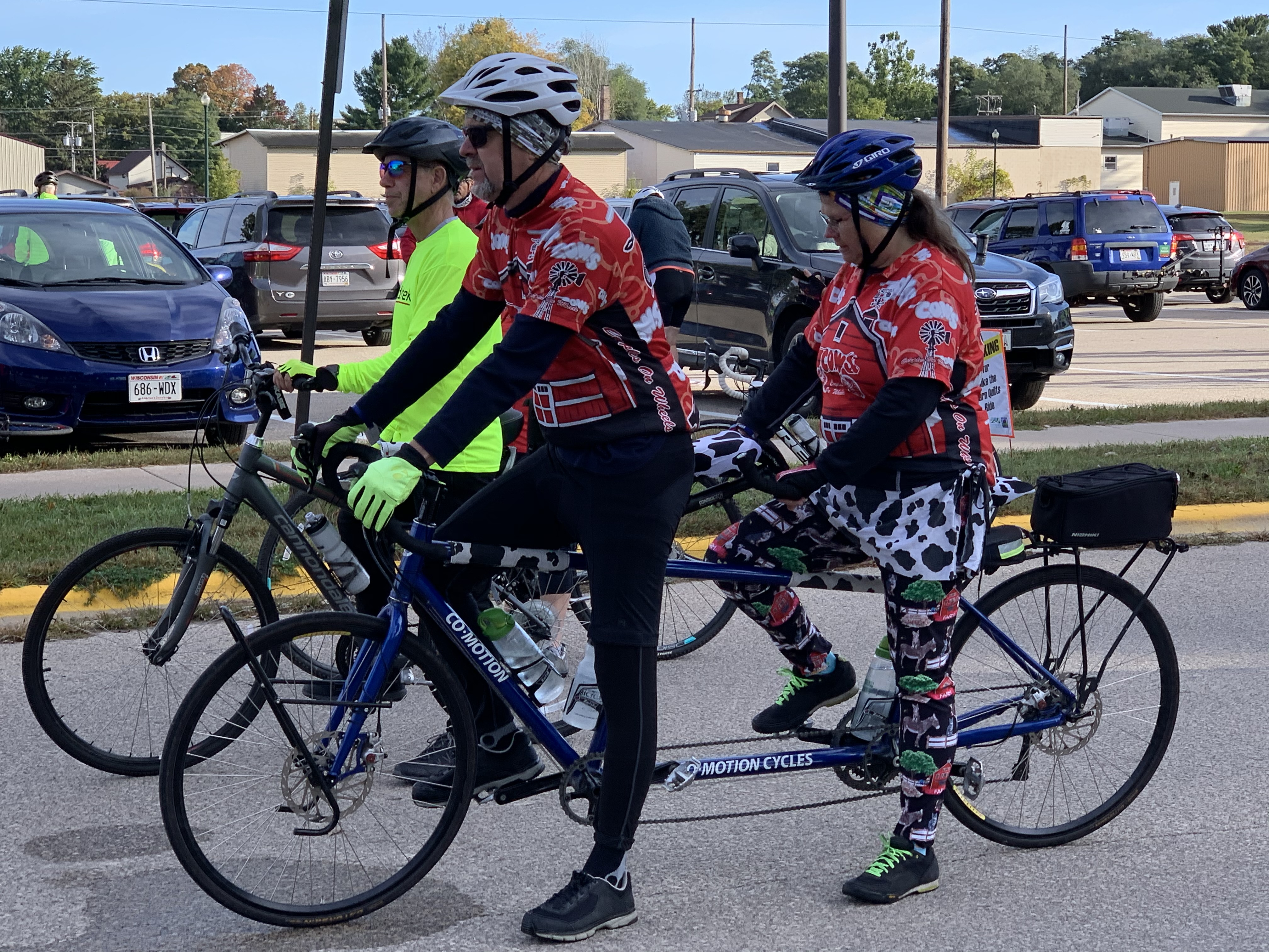 Stan and Laurie Frey, of Oconomowoc, listen to instructions before they begin their journey on a double bike at the Bike the Barn Quilts event at Memorial Park on Sept. 25.Luke Reimer   NEW Media