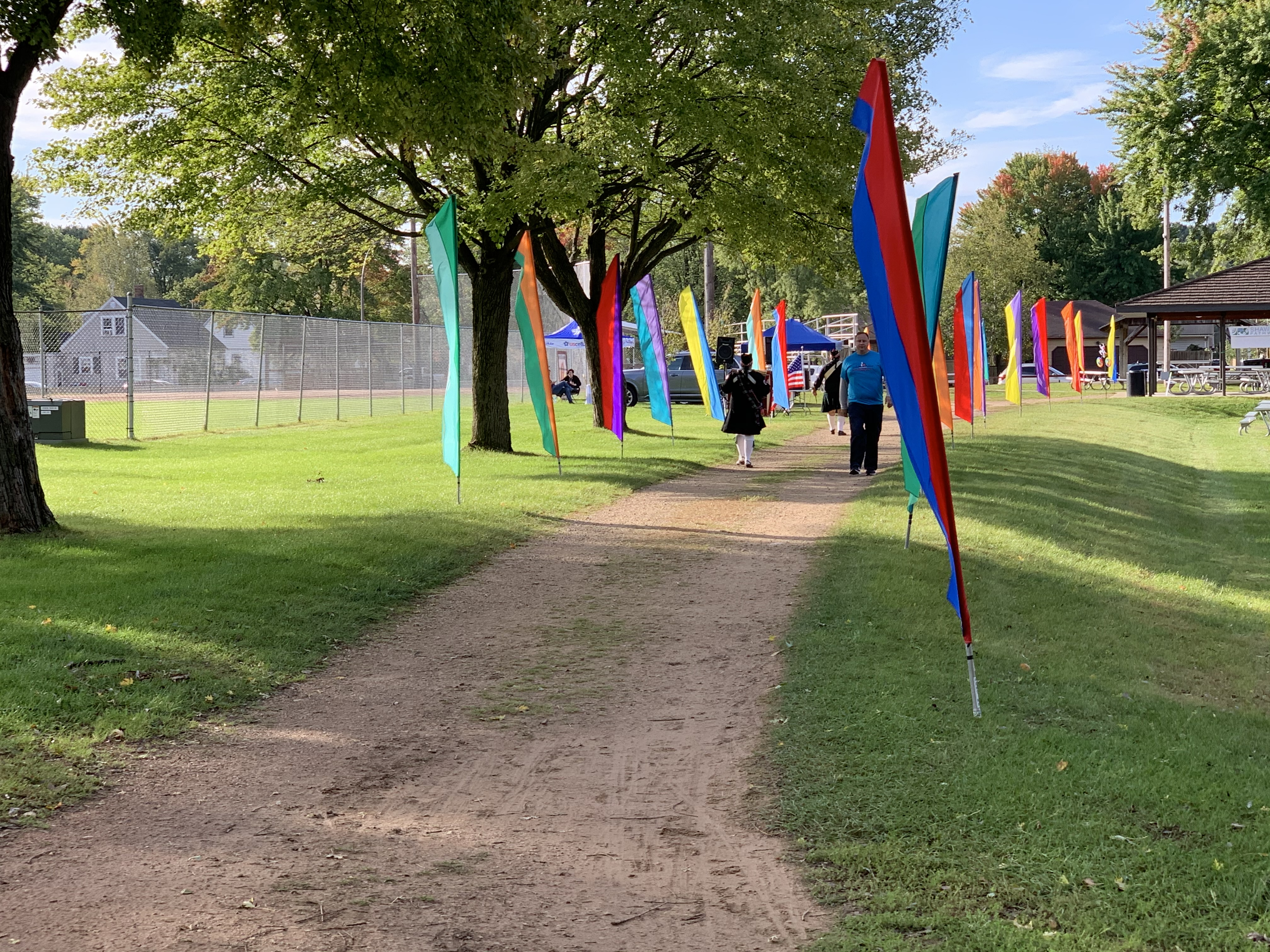 Banners indicate a path for visitors to find the starting line at the Bike the Barn Quilts event in Memorial Park on Sept. 25.Luke Reimer   NEW Media