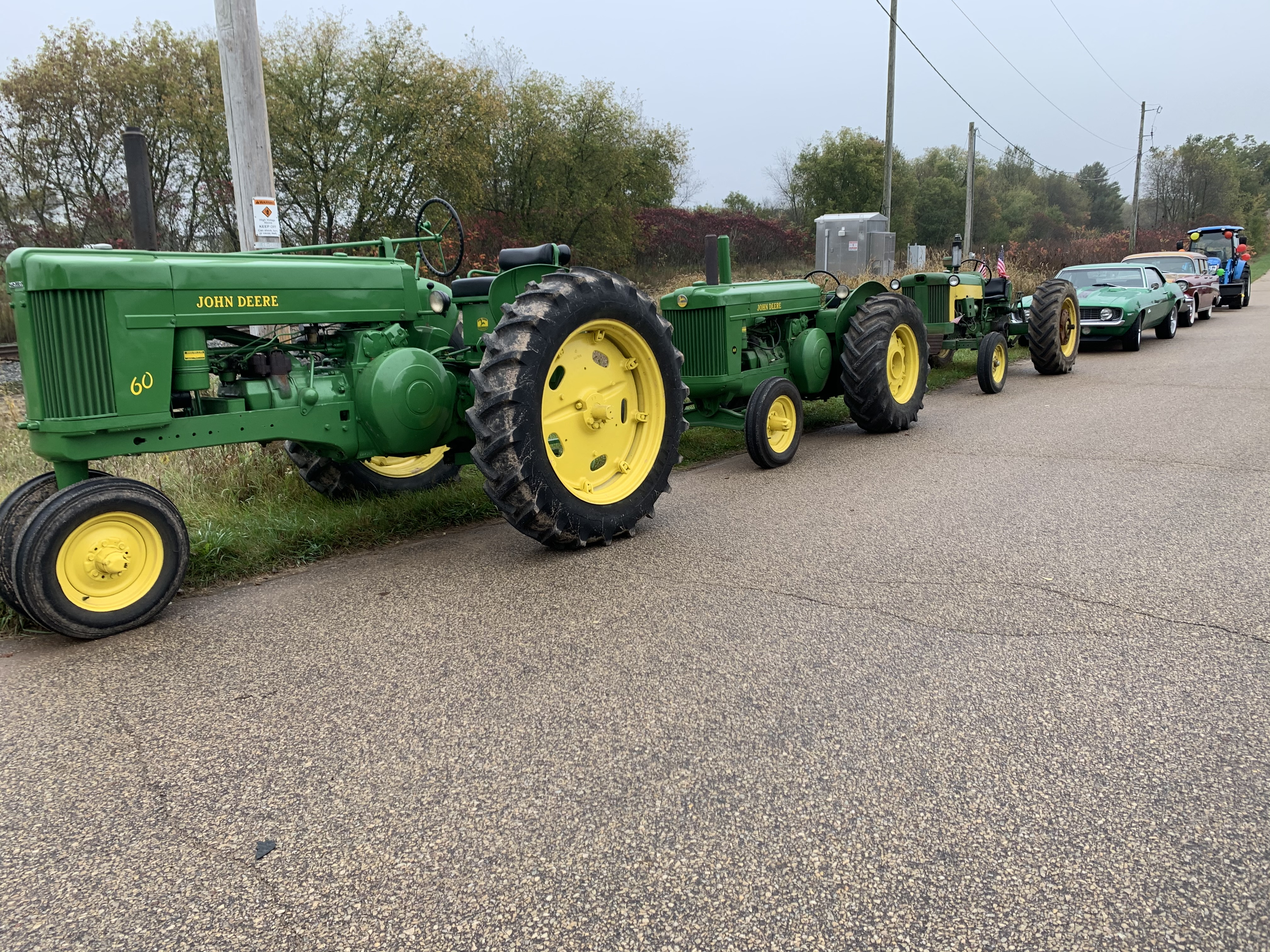 Tractors and vintage cars line up on County Road T in Lunds in preparation for the Bohemian Fest parade Oct. 9.Luke Reimer   NEW Media