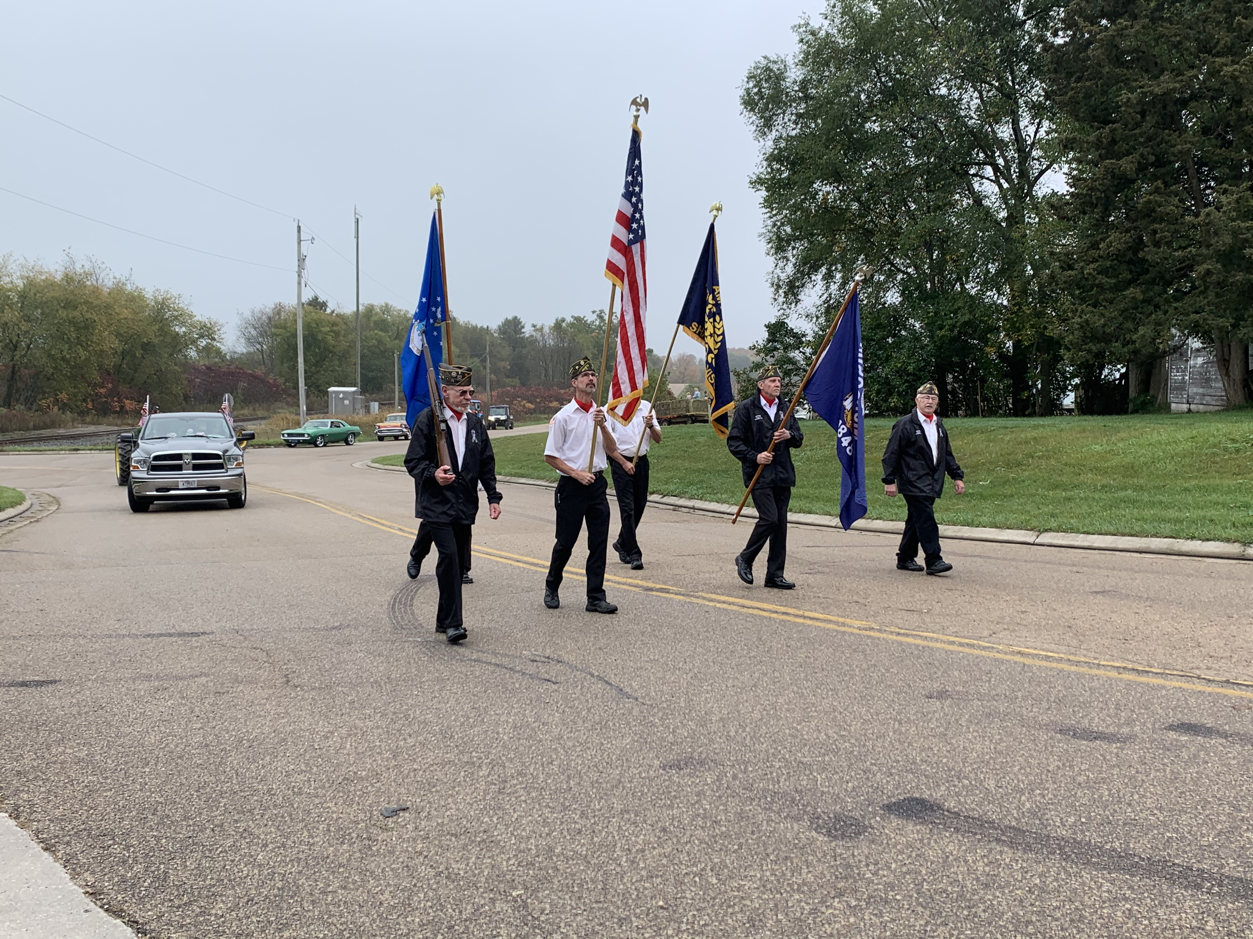 Members of the American Legion Post lead the parade down County Road T in Lunds during Bohemian Fest at Lunds Corner Bar on Oct. 9.Luke Reimer   NEW Media
