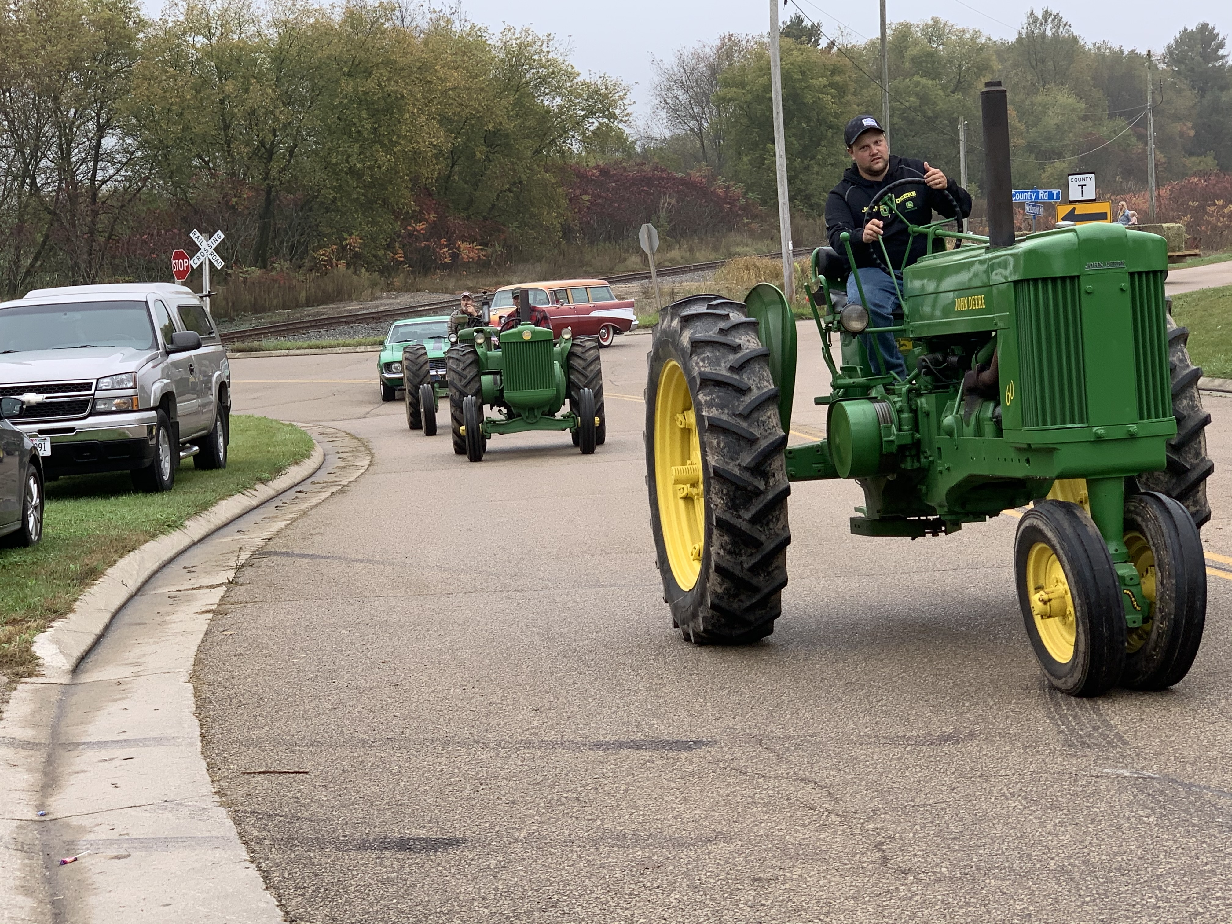 Tractors ride down County Road T in Lunds during the Bohemian Fest parade at Lunds Corner Bar on Oct. 9.Luke Reimer   NEW Media