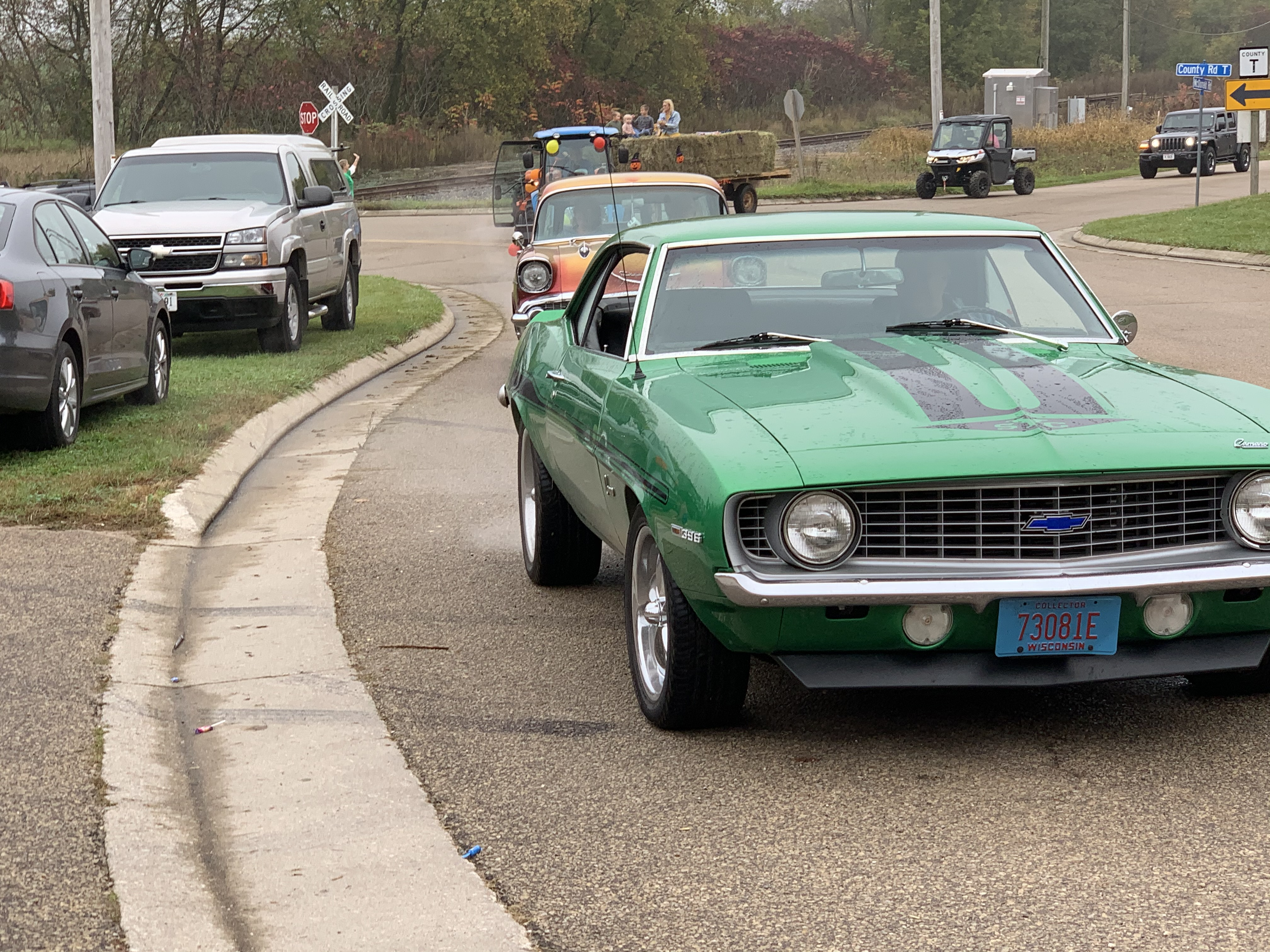 Vintage cars travel down County Road T while passengers throw candy to spectators at Bohemian Fest during the Oct. 9 parade.Luke Reimer   NEW Media