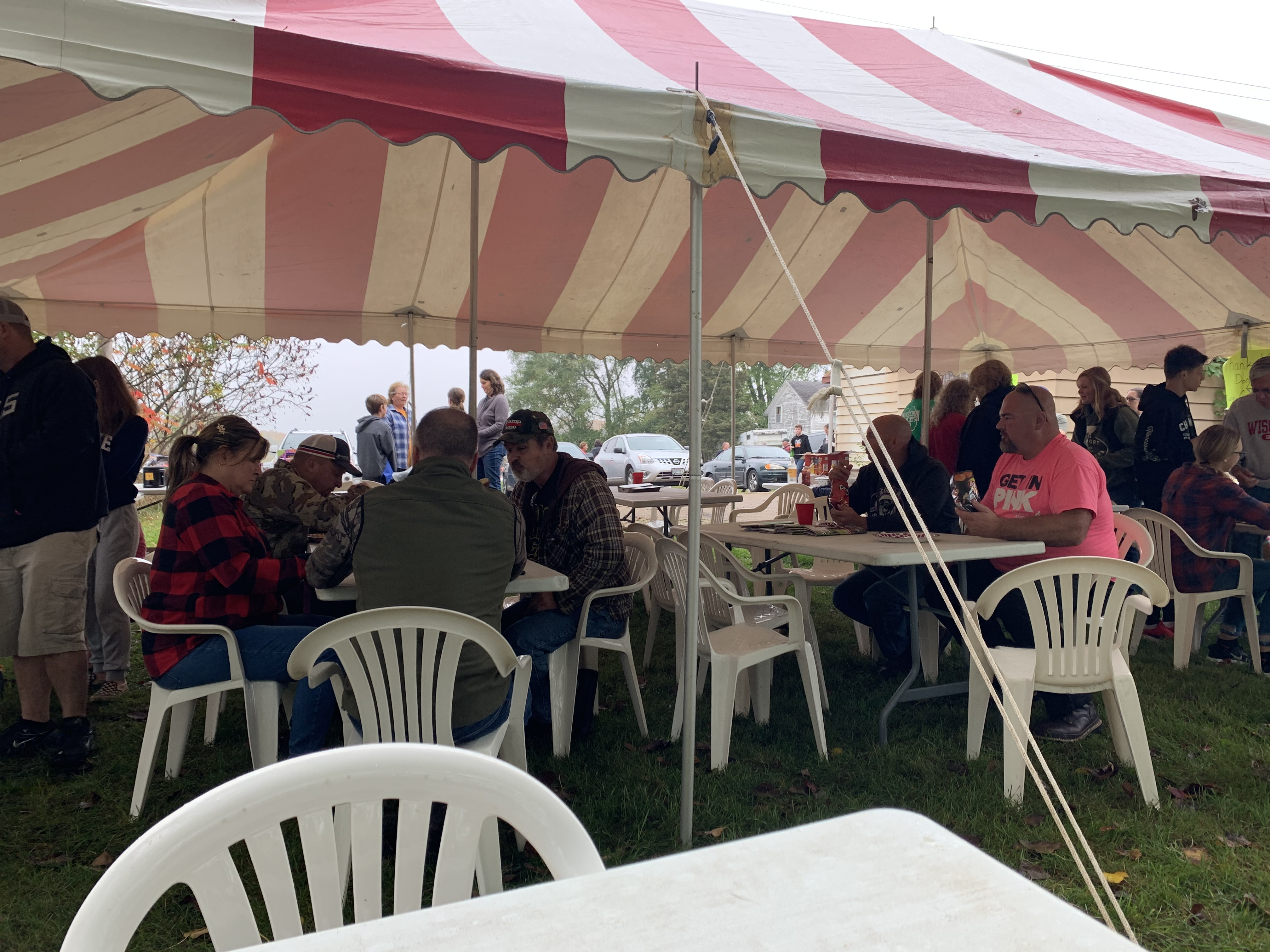 Visitors pack the tent outside of Lunds Corner Bar for Bohemian Fest, where they tuck in to a lunch of Polish sausage, sauerkraut and German potato salad.Luke Reimer   NEW Media