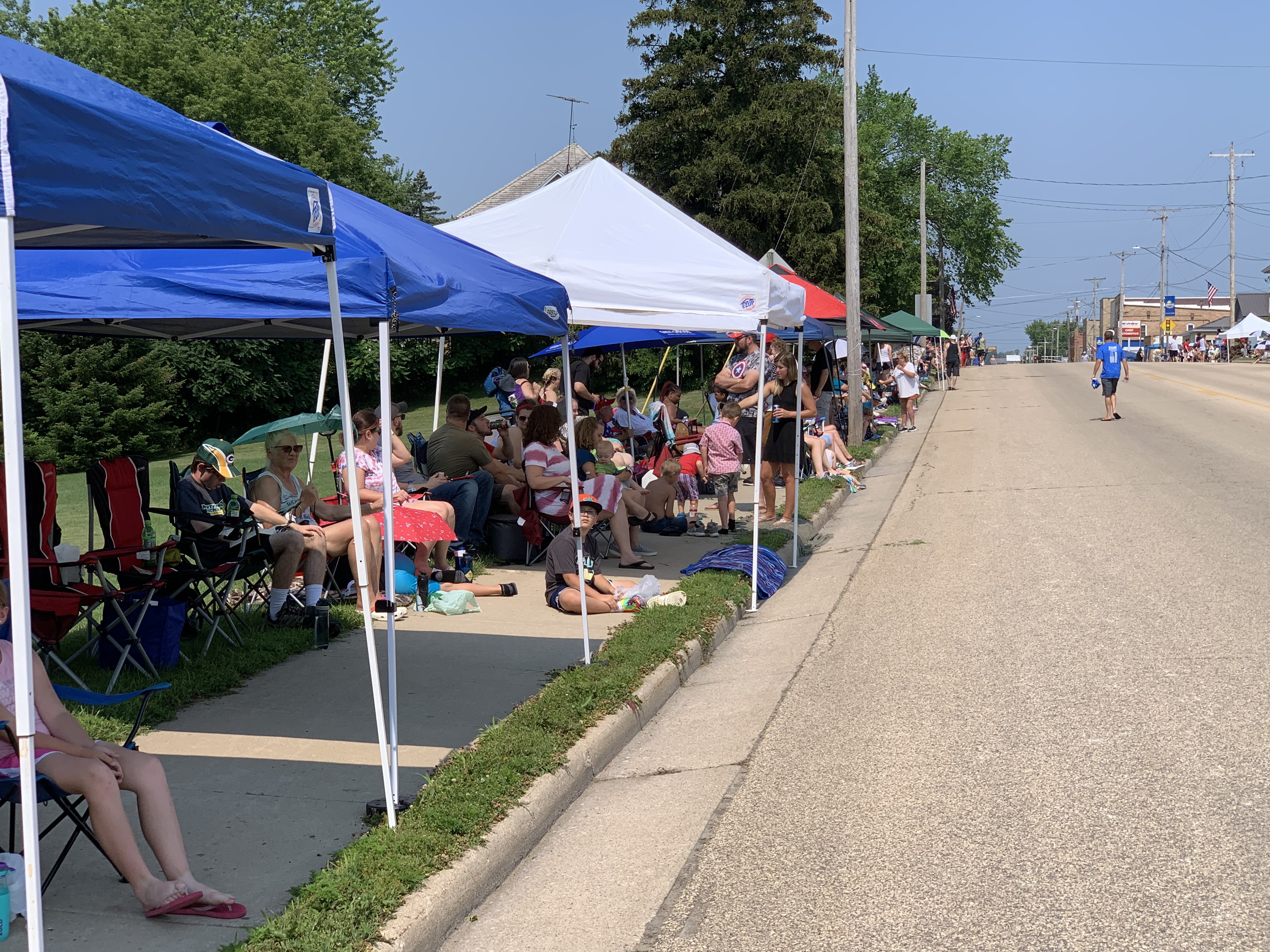 Green Bay Street was filled with tents as residents and visitors braved the heat to watch the Fourth of July parade pass in Bonduel on July 4.Luke Reimer | NEW Media