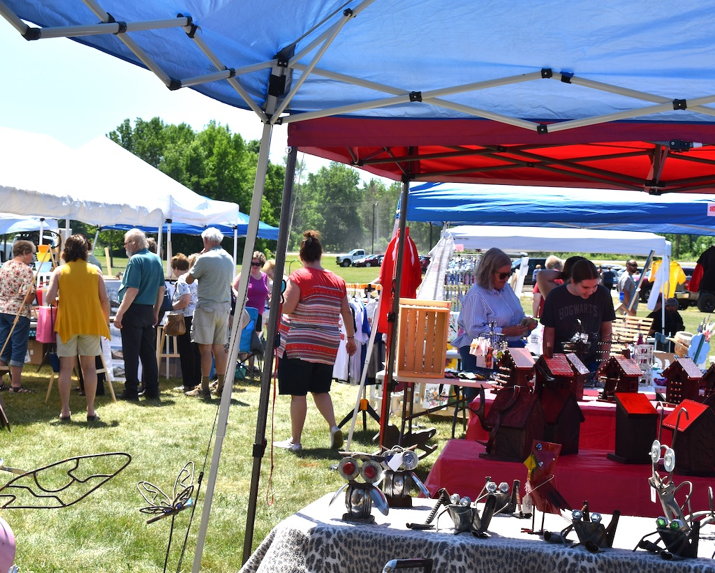 Shoppers browse in the sun among the booths June 13 at the Chase Stone Barn Crafts Show.<br />Warren Bluhm | NEW Media