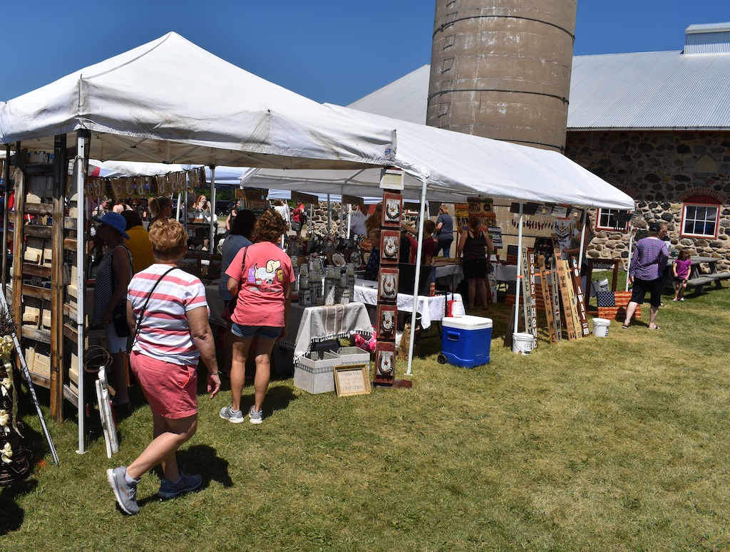 The June 13 craft show at the Chase Stone Barn drew a wide variety of vendors and shoppers alike.<br />Warren Bluhm | NEW Media