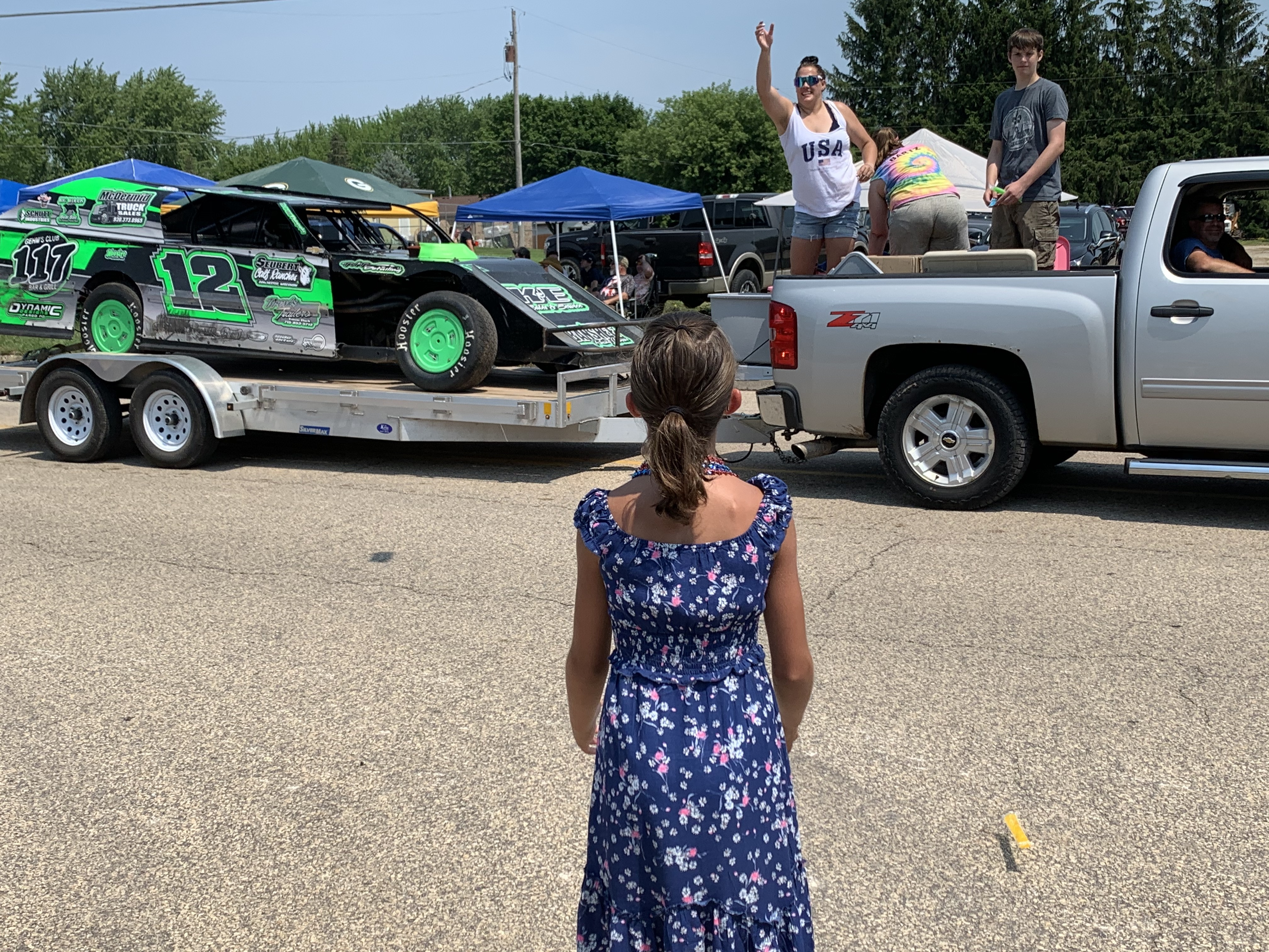 Amelia Buckoski looks on as she awaits candy to be thrown at the Fourth of July parade in Bonduel on July 4.Luke Reimer | NEW Media