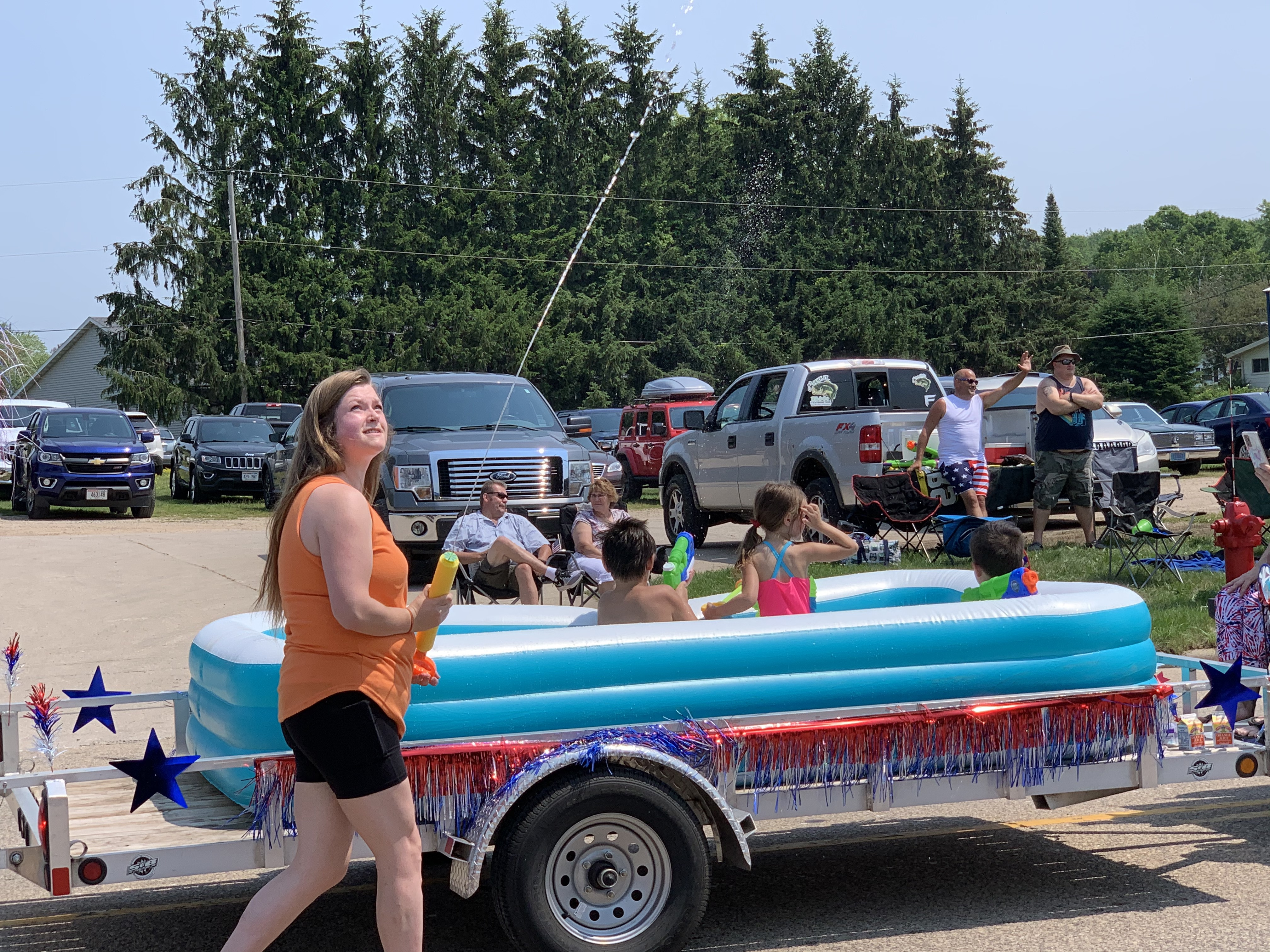 Water was squirted to cool visitors of the Fourth of July parade as temperatures reached 90 degrees in Bonduel on July 4.Luke Reimer | NEW Media