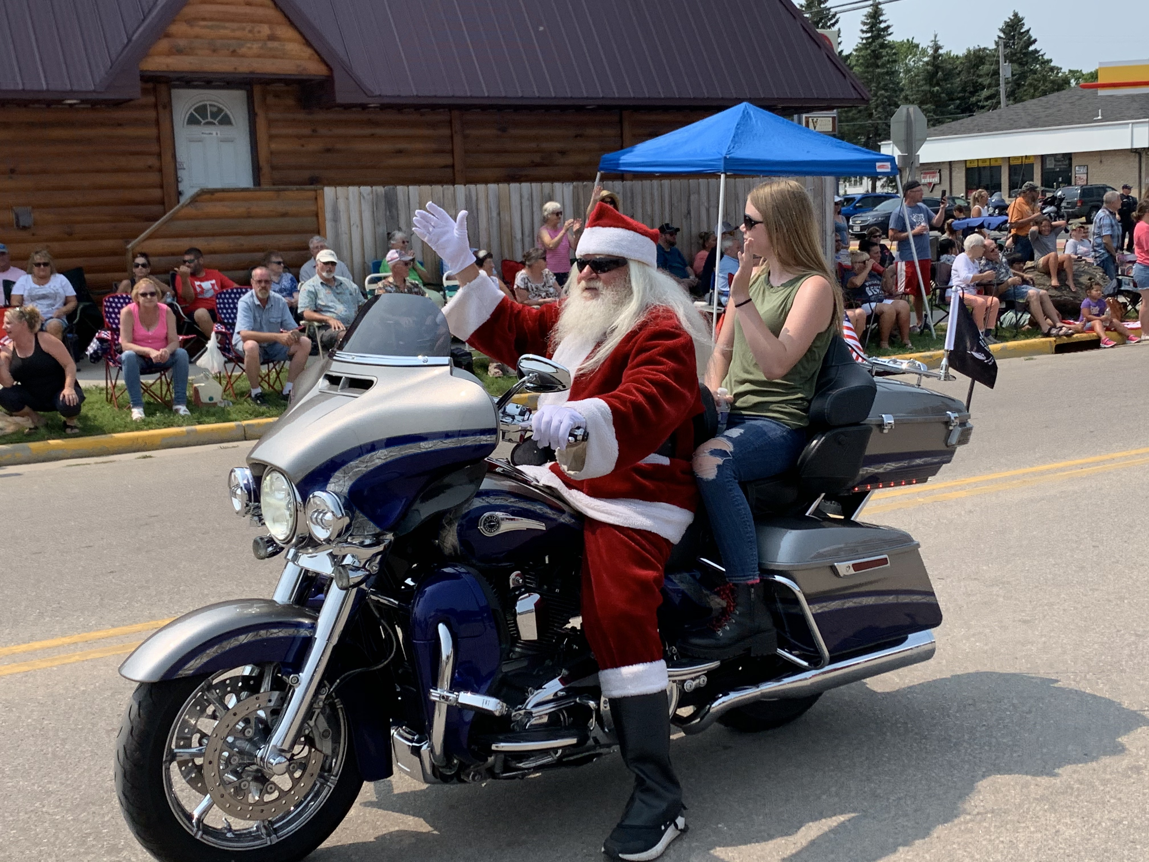Santa Claus made an early appearance this year, as he drives a motorcycle with a passenger down Pulaski Street on July 18.Luke Reimer   NEW Media