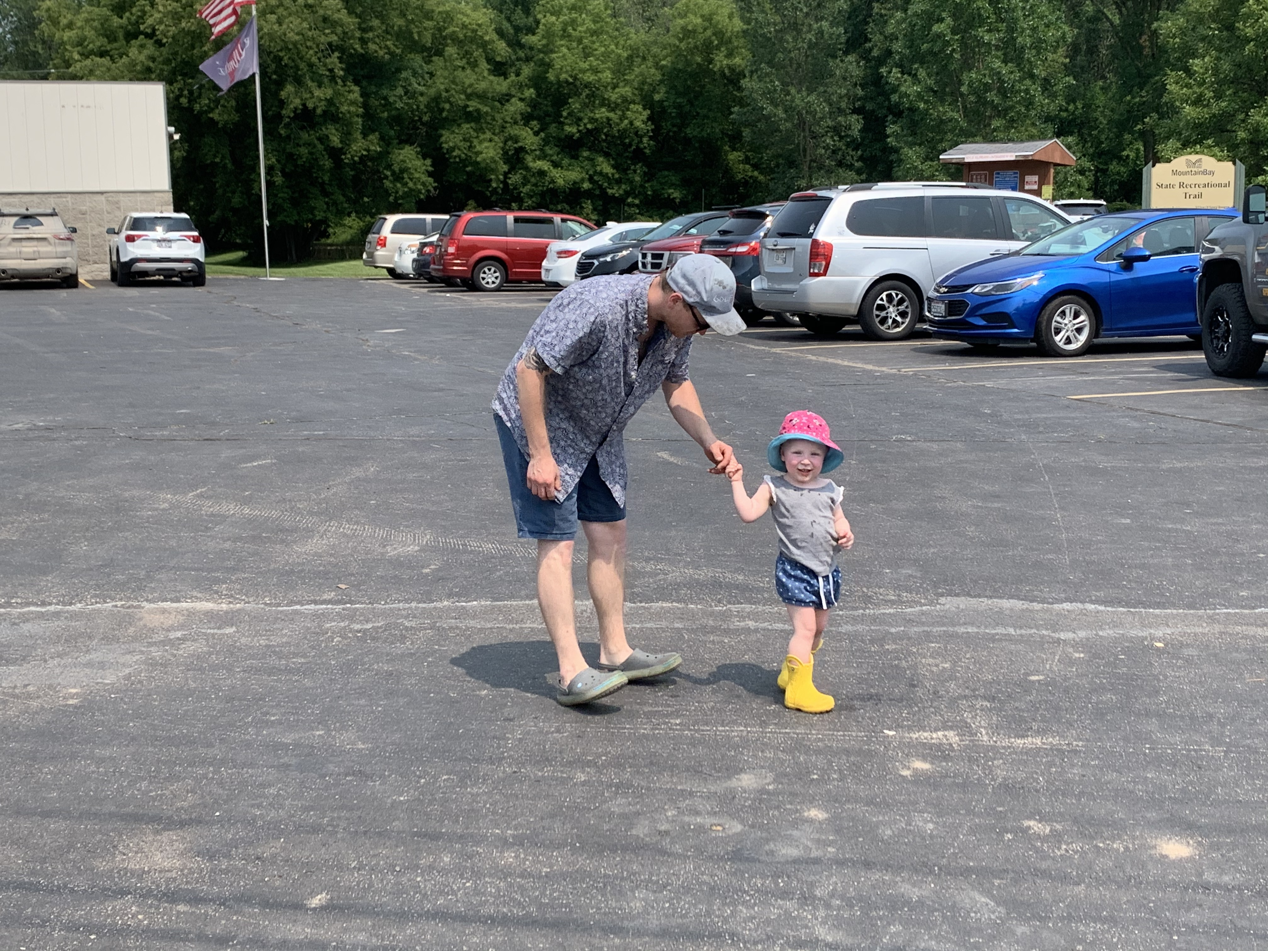Ellie VanDamn is all smiles as she dances with her father, Codes, in parking lot off of Pulaski Street on July 18. The VanDamn's were excited to see the parade as they live in Pulaski.Luke Reimer   NEW Media