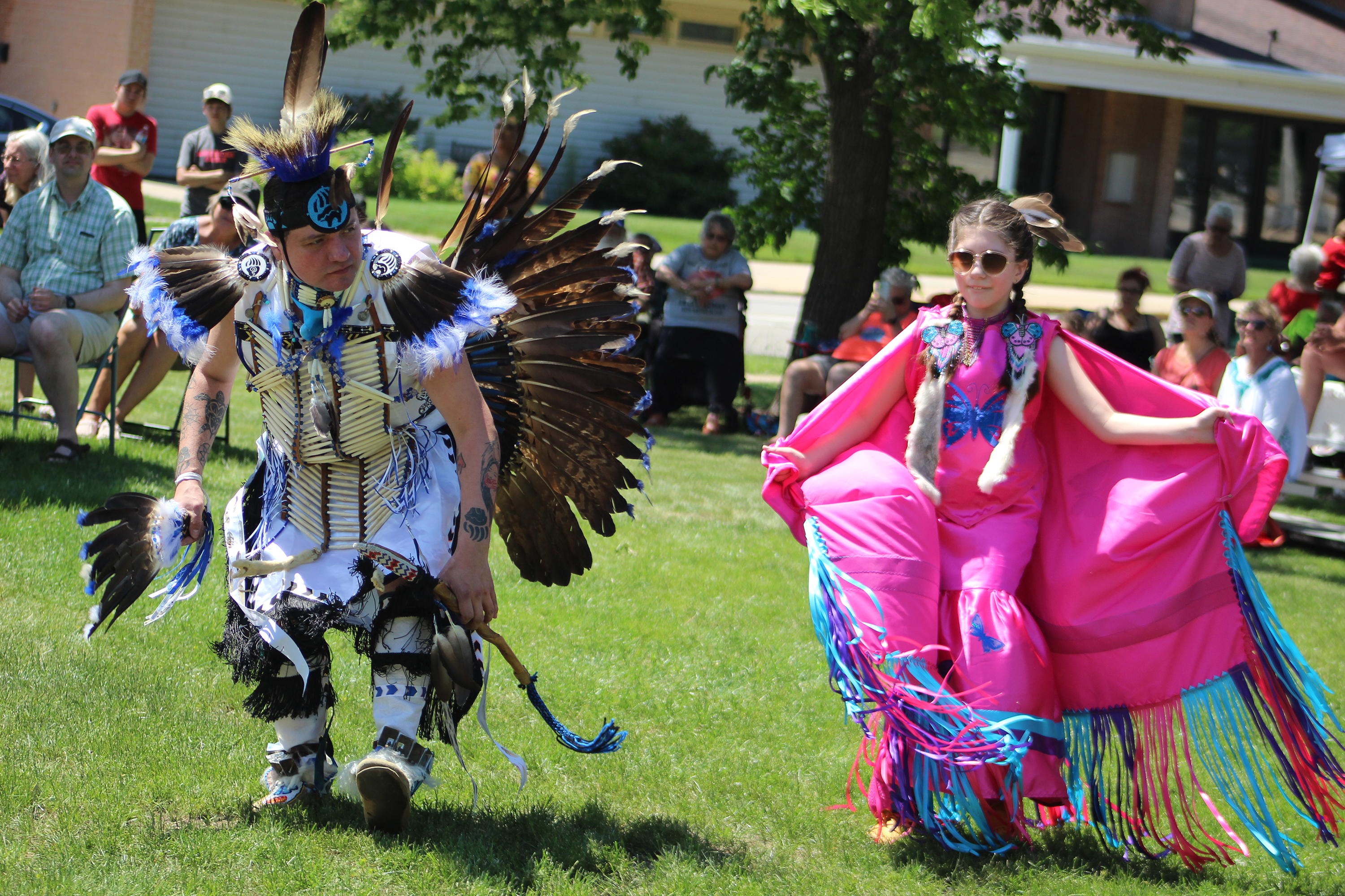 A special powwow for the Menominee Clans Story exhibit brought dancers and spectators out on a hot day June 5 as the museum and the tribe celebrated some special wood figures crafted by the late James Frechette.(Lee Pulaski   NEW Media)