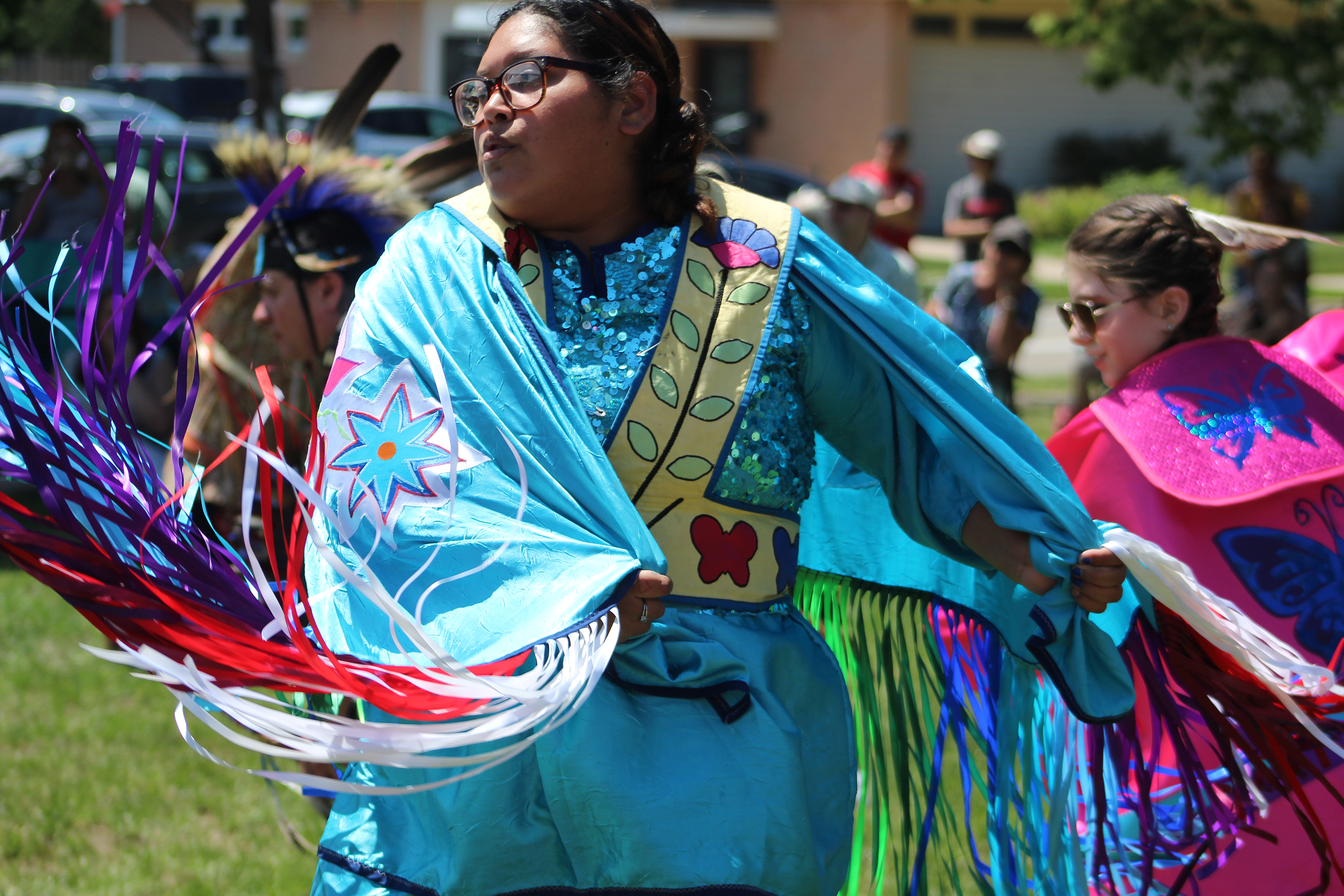 Powwow dancers were awash in color June 5 as they made their way around the makeshift arena set up on the lawn of the Oshkosh Public Museum for the opening of the Menominee Clans Story exhibit.(Lee Pulaski   NEW Media)