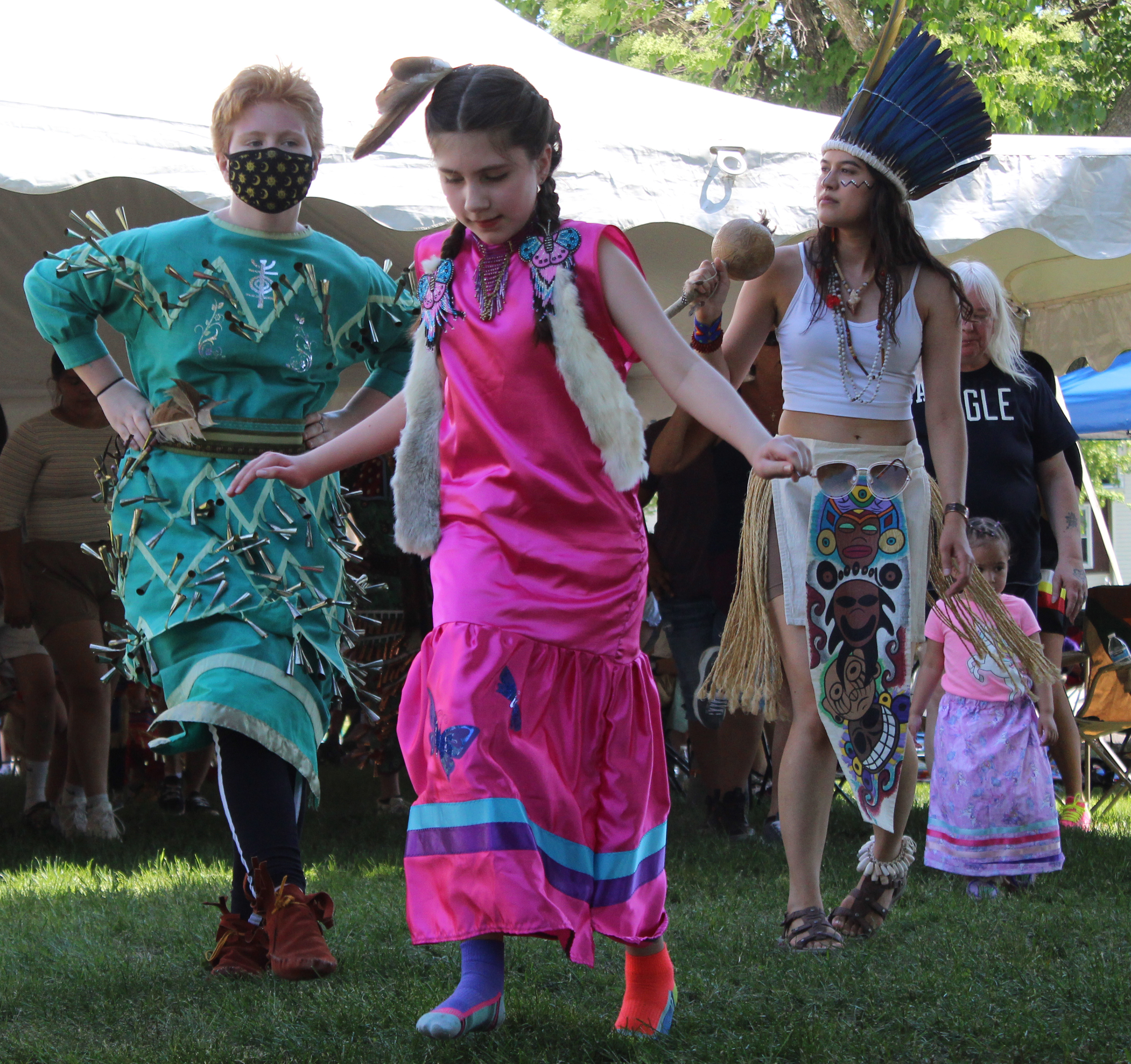 Several dancers move to the beat of the drums in the arena set up outside Oshkosh Public Museum during the June 5 opening of the Menominee Clans Story exhibit.(Lee Pulaski   NEW Media)