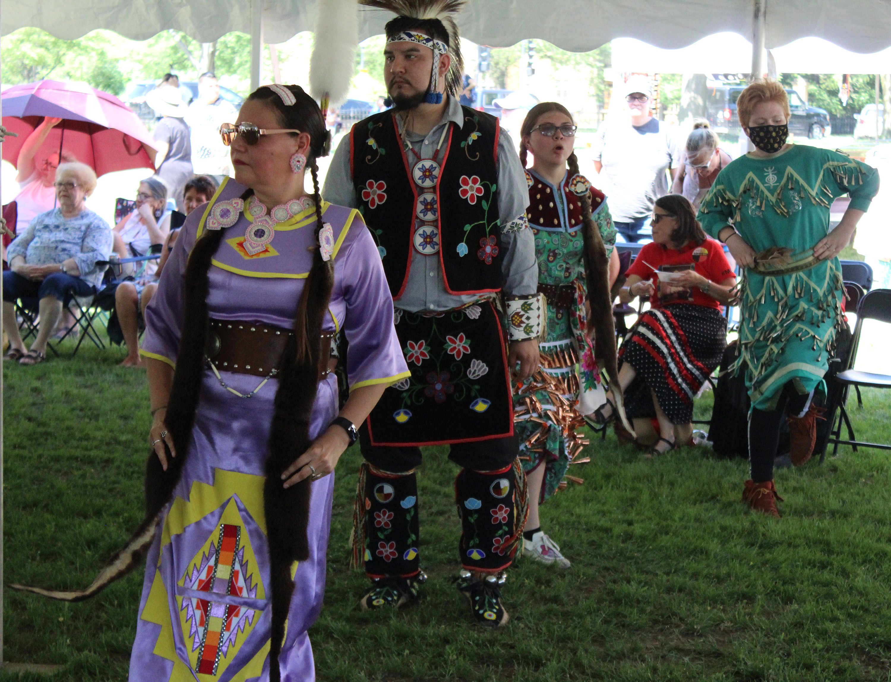 A number of powwow dancers felt cooler under the tent June 5 at Oshkosh Public Museum as they celebrate the opening of the Menominee Clans Story.(Lee Pulaski   NEW Media)