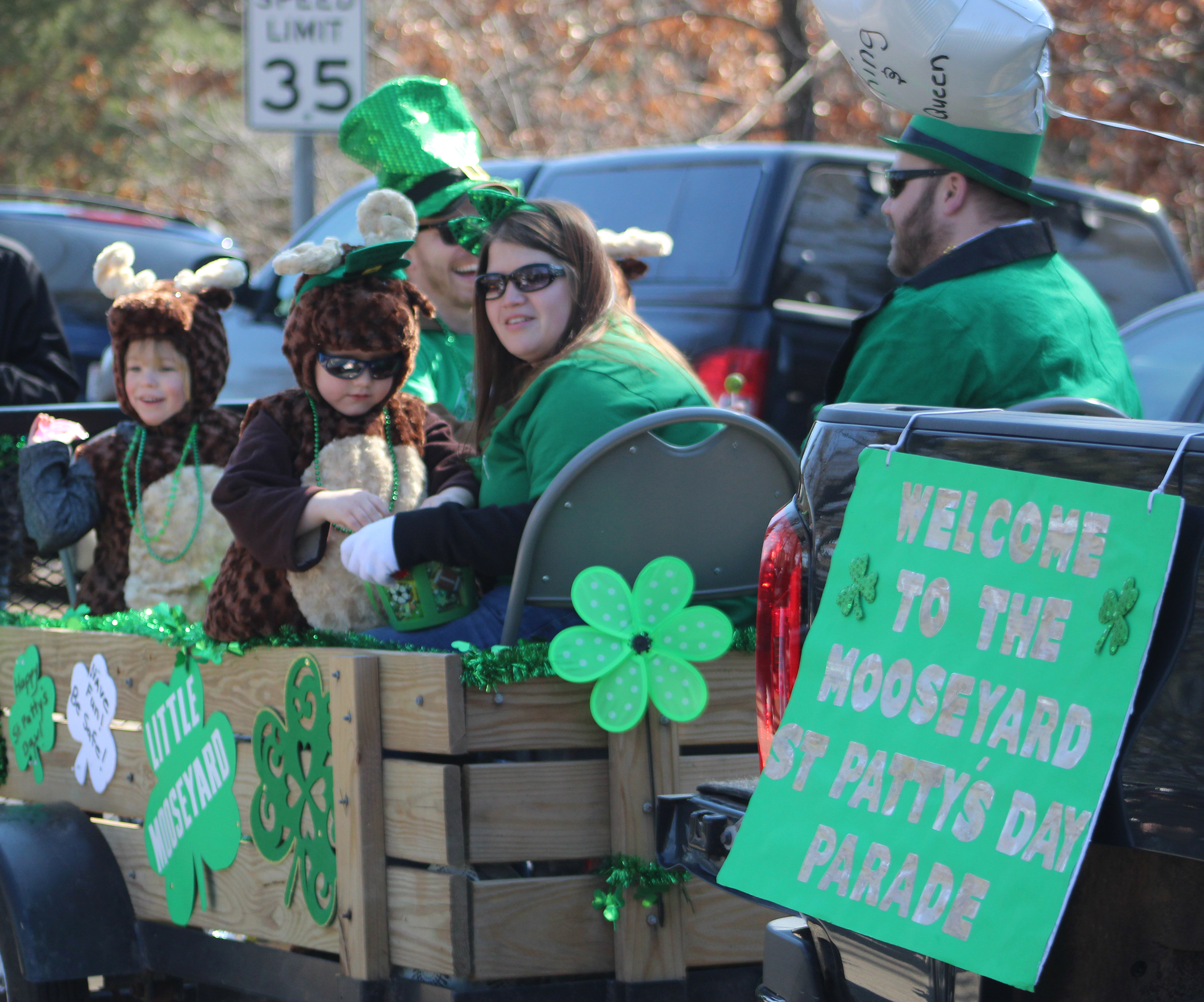 Plenty of folks wearing green or dressing up as moose could be found on the Little Mooseyard float, one of the first floats in the 2021 St. Patrick's Day parade welcoming visitors to the parade. Both sides of the street were packed with people excited to get out and enjoy a parade after COVID-19 canceled more than a year's worth of events throughout the area.(Lee Pulaski   NEW Media)