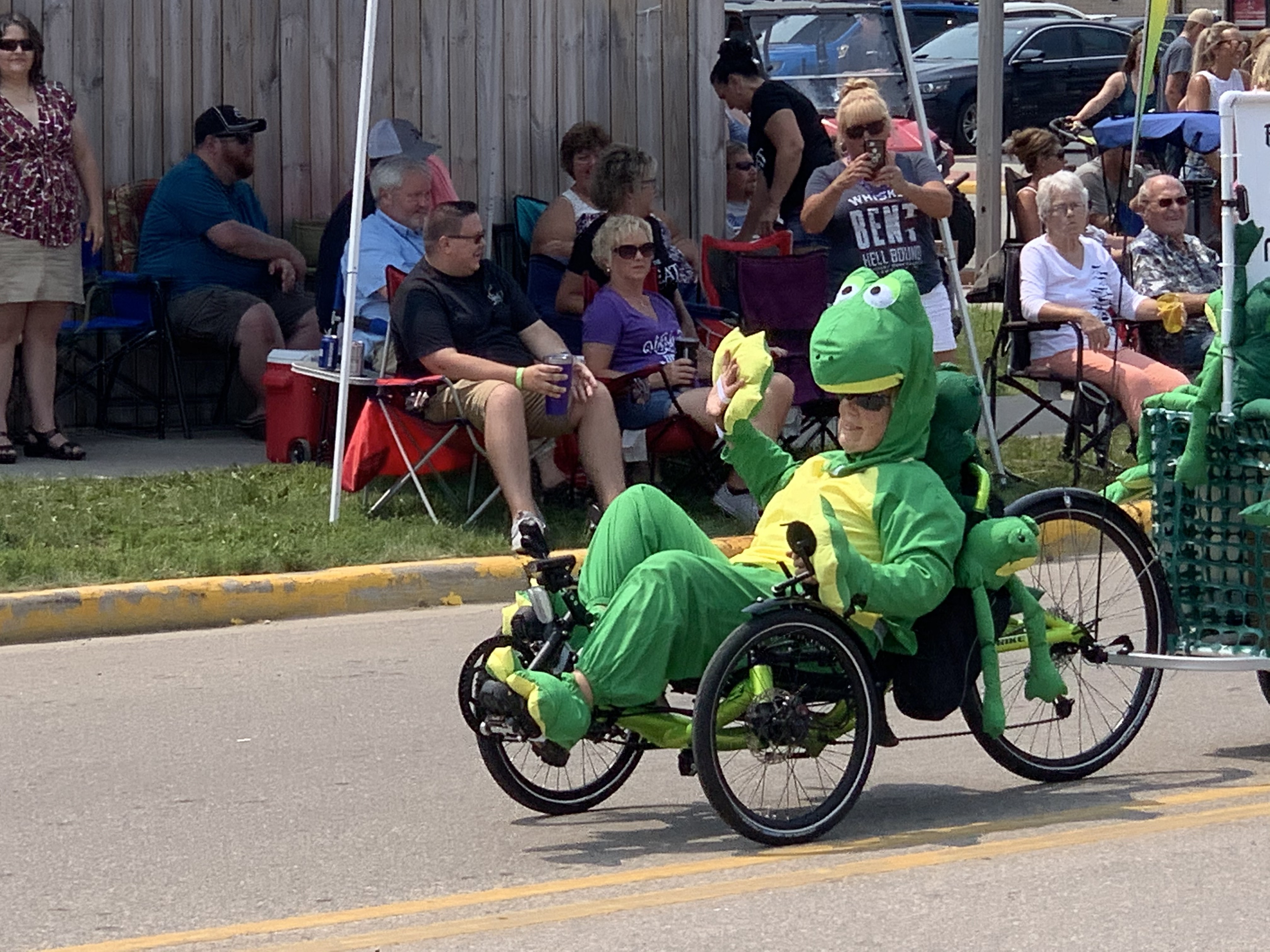 A woman dressed as a frog rides a four wheel bicycle through Pulaski Street on July 18.Luke Reimer   NEW Media