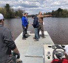 Members of Shawano Area Waterways Management ride out on the water in a channel that connects Shawano Lake and the Wolf River May 6 to place buoys in the water in preparation for boating season.  Greg Mellis | NEW Media