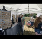 One of the most popular vendors at the Shawano Farmers Market in Franklin Park on June 19 was the booth that sold specialty made earrings and jewelry.  Luke Reimer | NEW Media