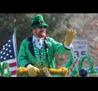 Jim Starks, grand marshal for the Mooseyard St. Patrick's Day parade, waves to onlookers as his float passes by near the beginning of the parade. There were plenty of people donning green for the annual event.  (Lee Pulaski | NEW Media)
