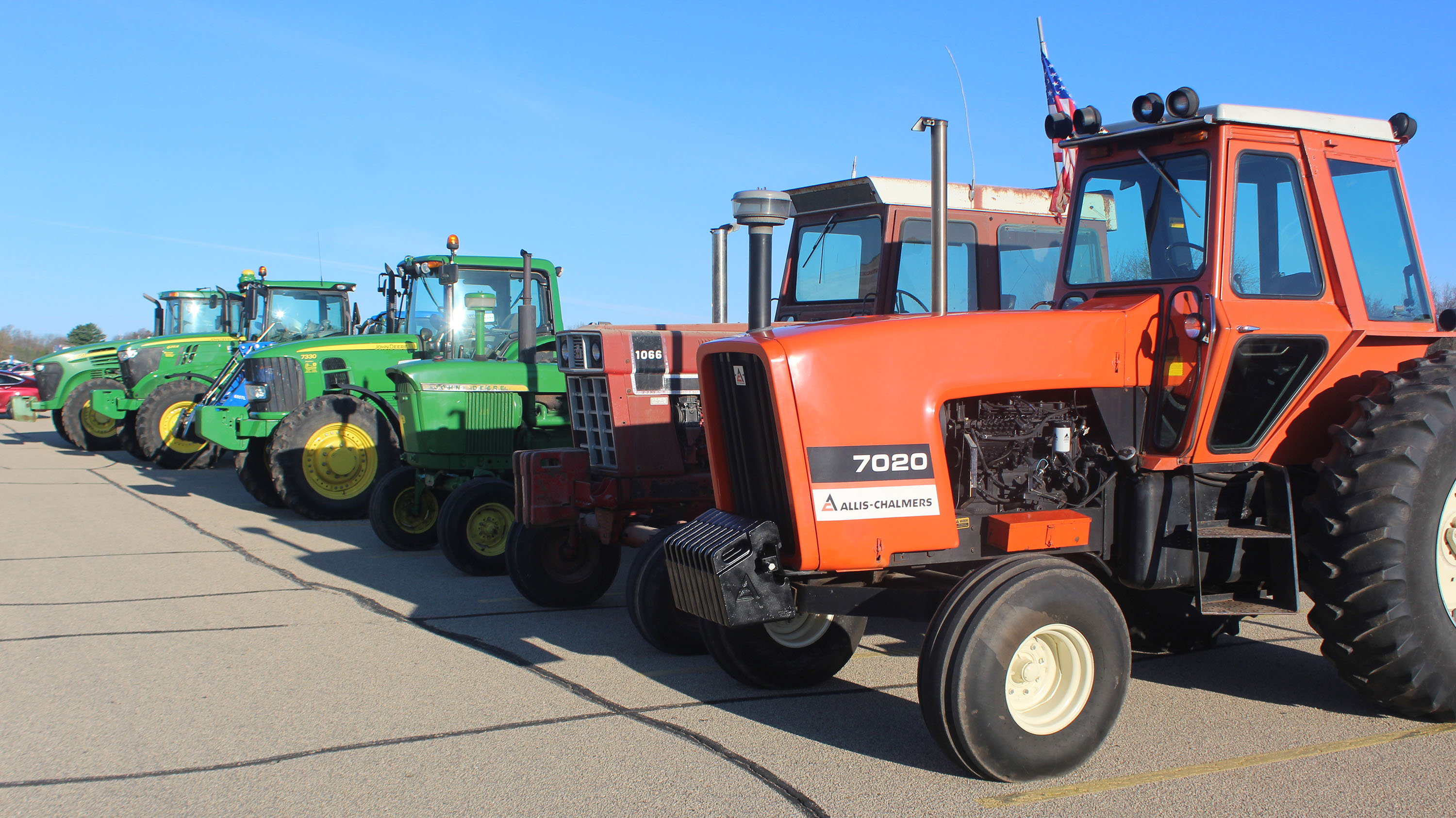 Tractors are lined up April 17 in the north parking lot of Shawano Community High School as the Shawano FFA celebrates its Drive Your Tractor to School Day.<br />(Lee Pulaski | NEW Media)